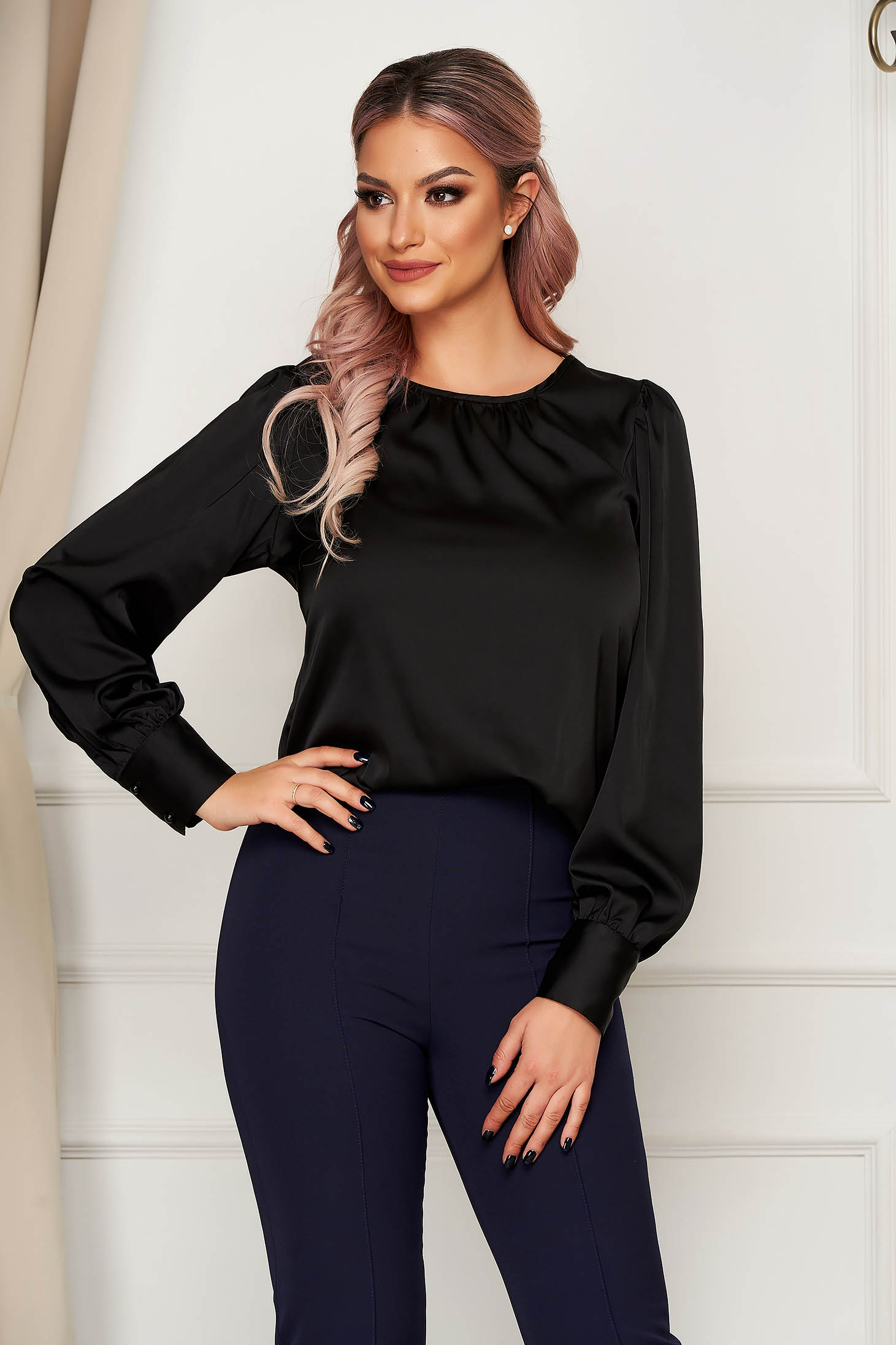 Black women`s blouse office flared from satin fabric texture