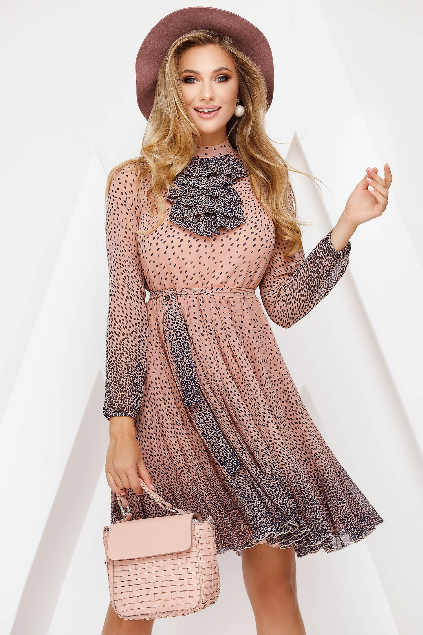 Elegant lightpink cloche dress from veil accessorized with breastpin