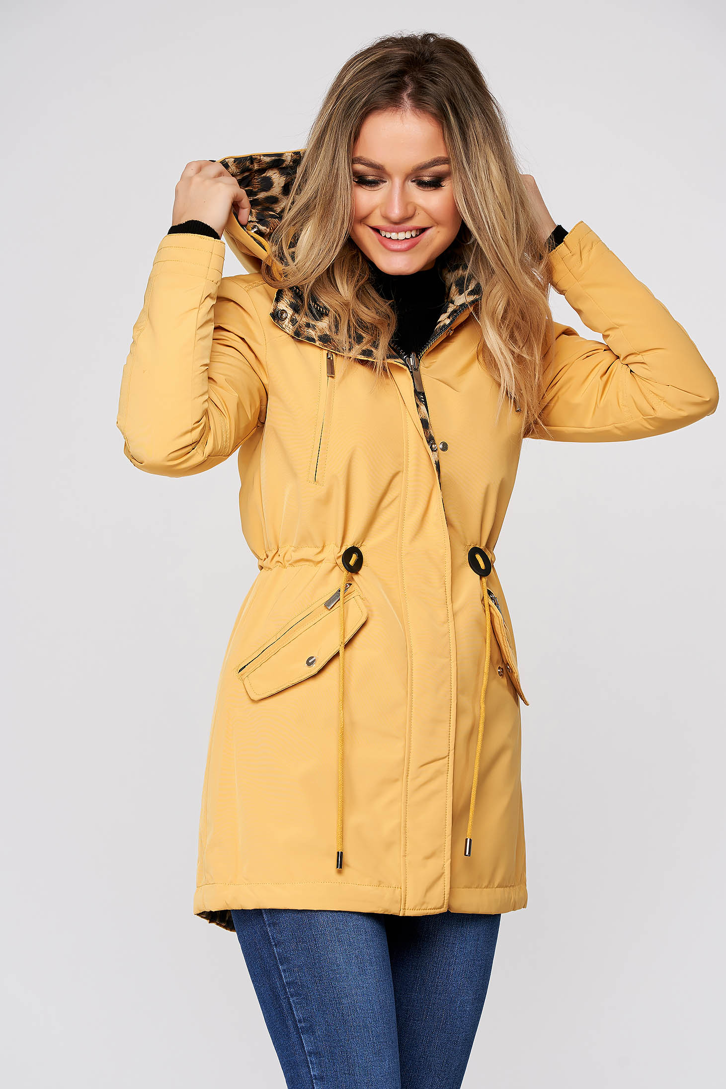 Yellow jacket casual from slicker double-faced is fastened around the waist with a ribbon