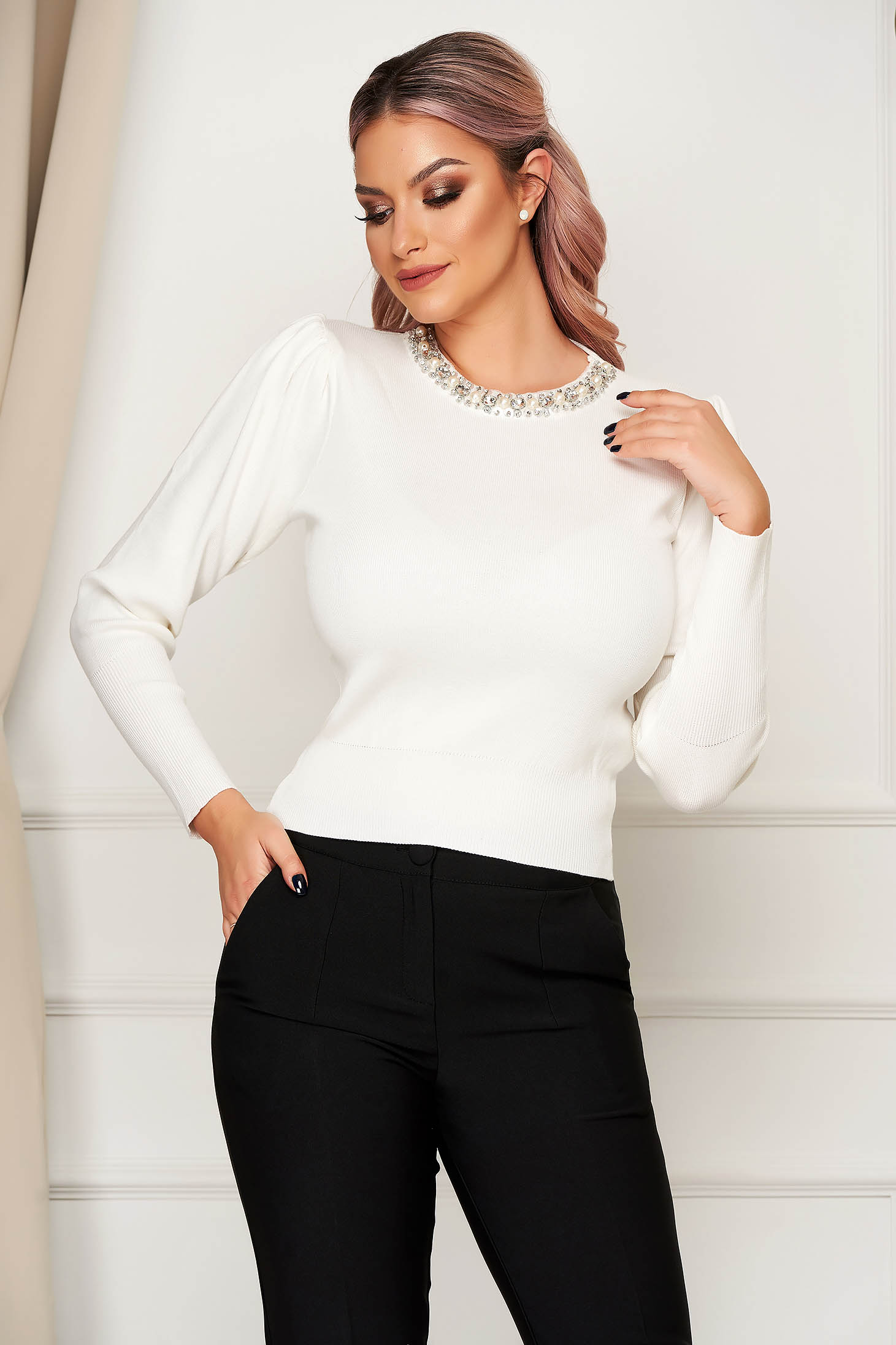 White sweater elegant knitted with tented cut high shoulders