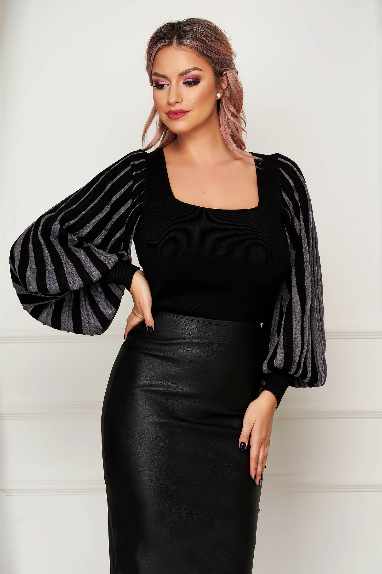 Black women`s blouse casual knitted with tented cut with puffed sleeves