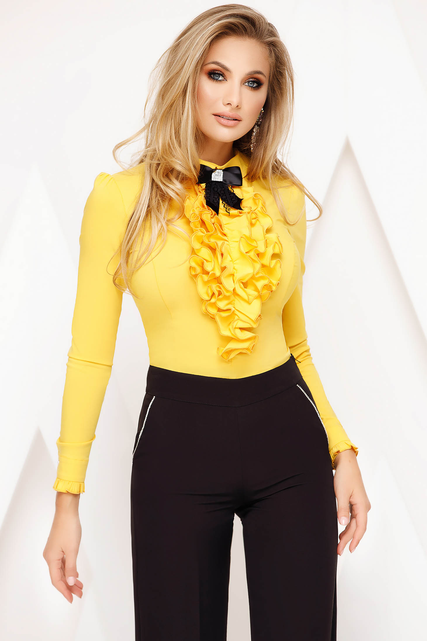 Yellow women`s blouse office tented cotton accessorized with breastpin