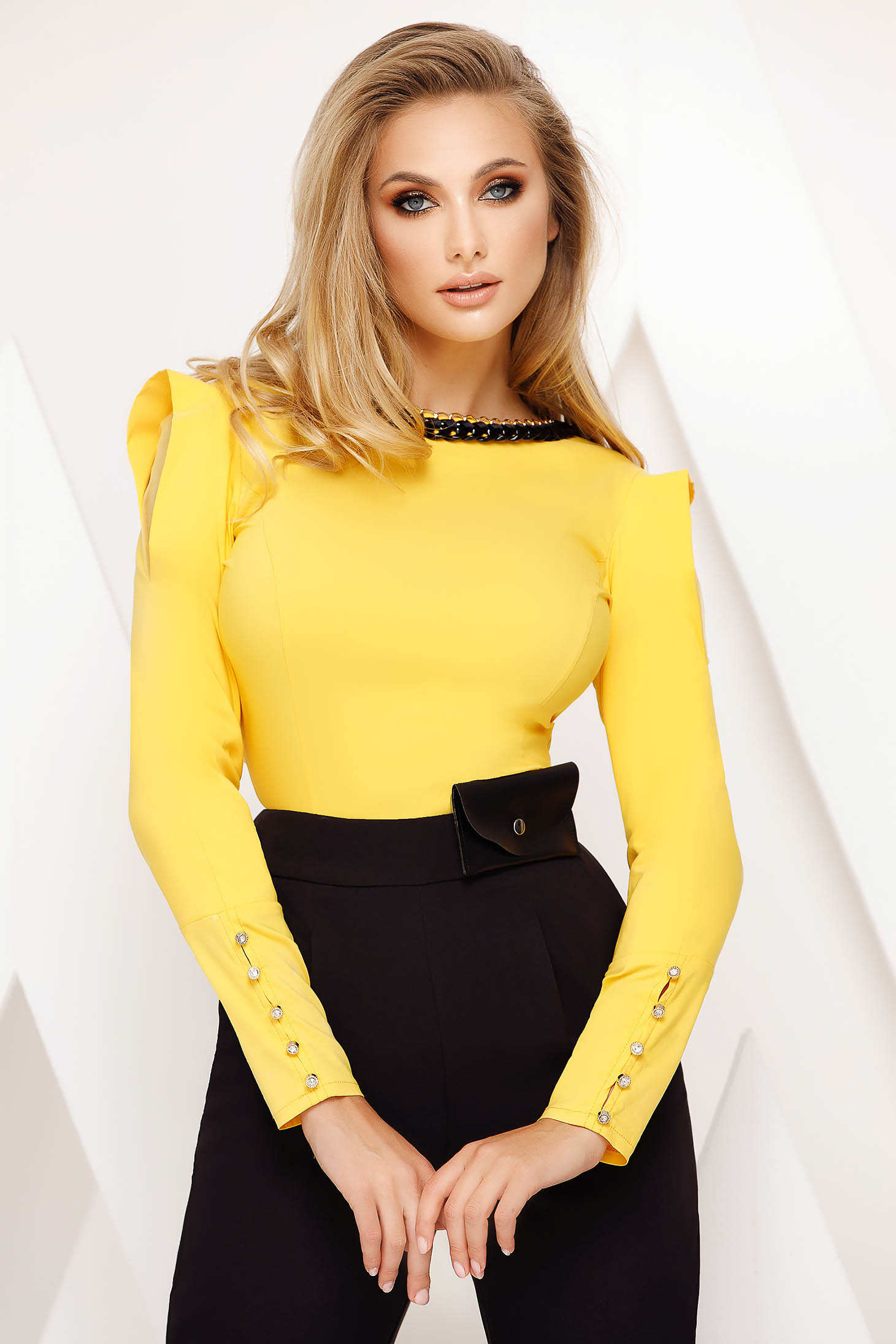 Women`s shirt yellow office with tented cut slightly elastic cotton accessorized with chain
