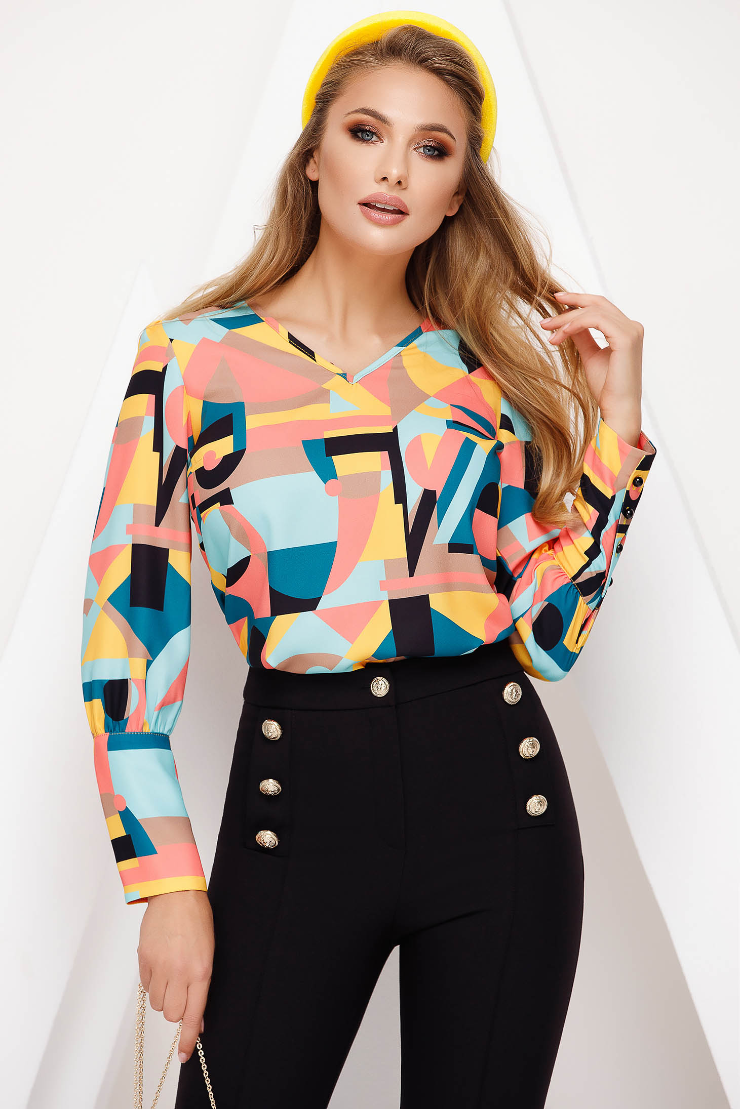 Elegant blue women`s blouse with v-neckline flared with geometrical print