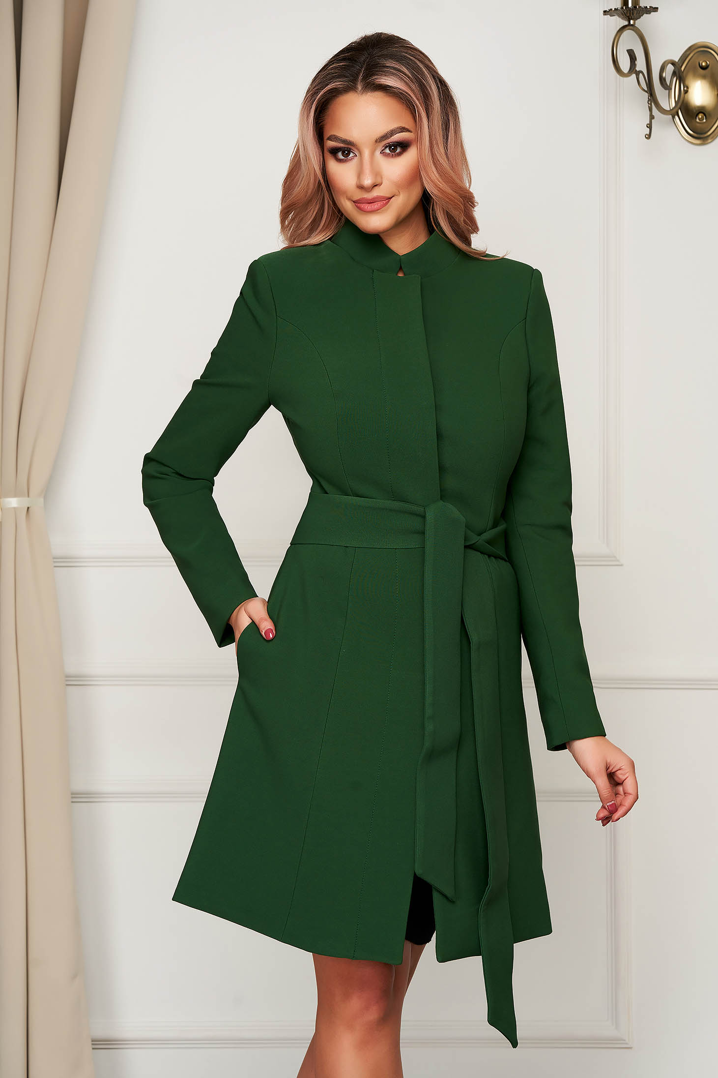 Cloche with inside lining accessorized with tied waistband elegant with bow green overcoat