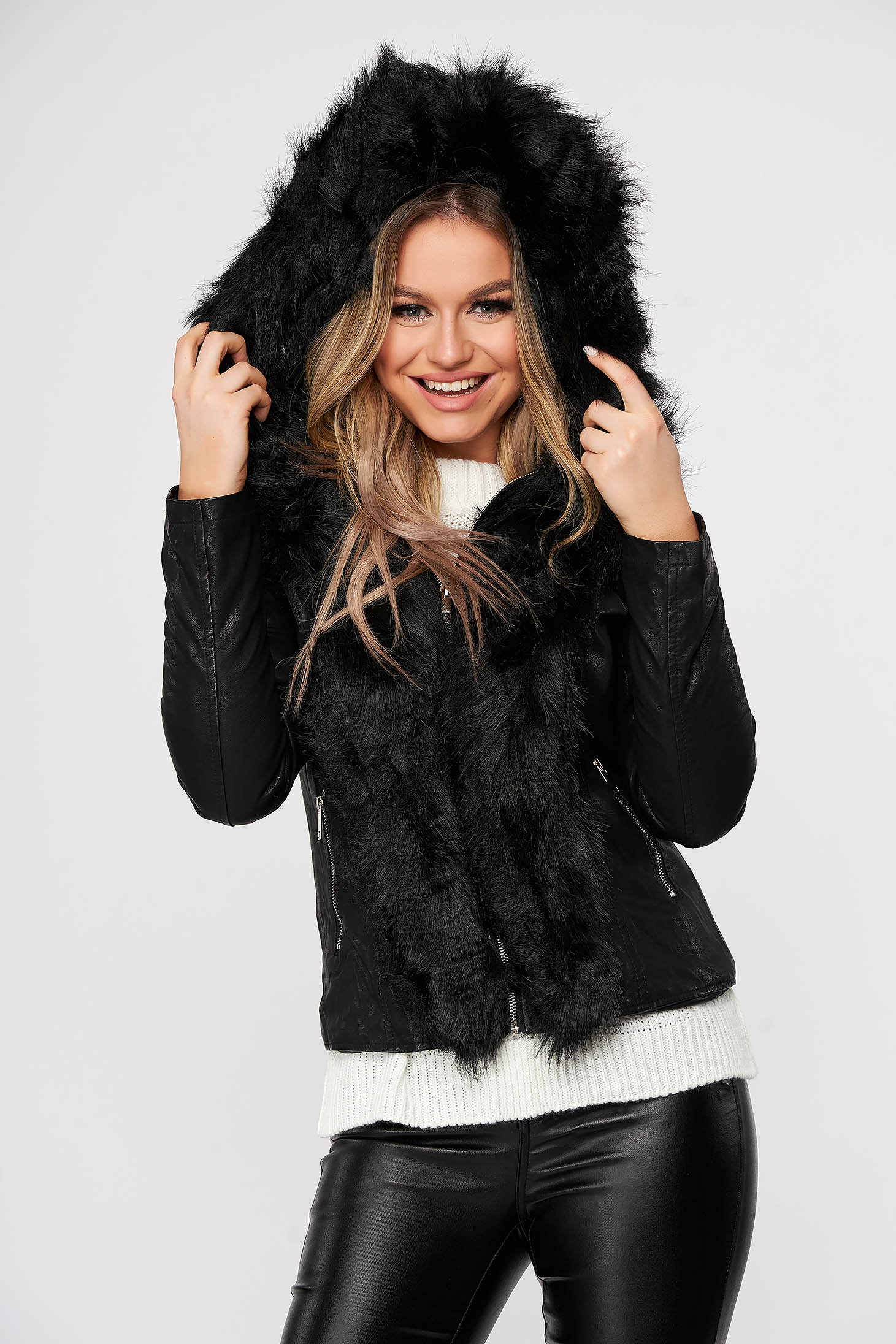 Black jacket from ecological leather with furry hood with faux fur details