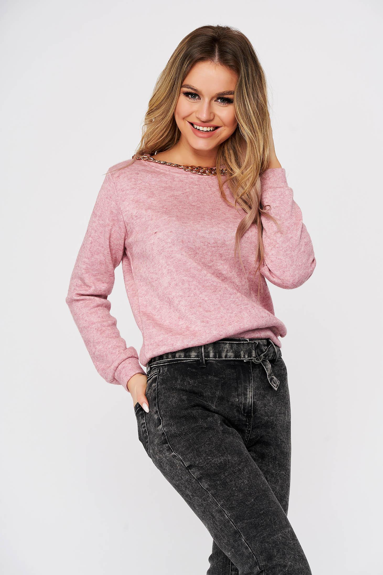 Pink sweater neckline metallic chain accessory