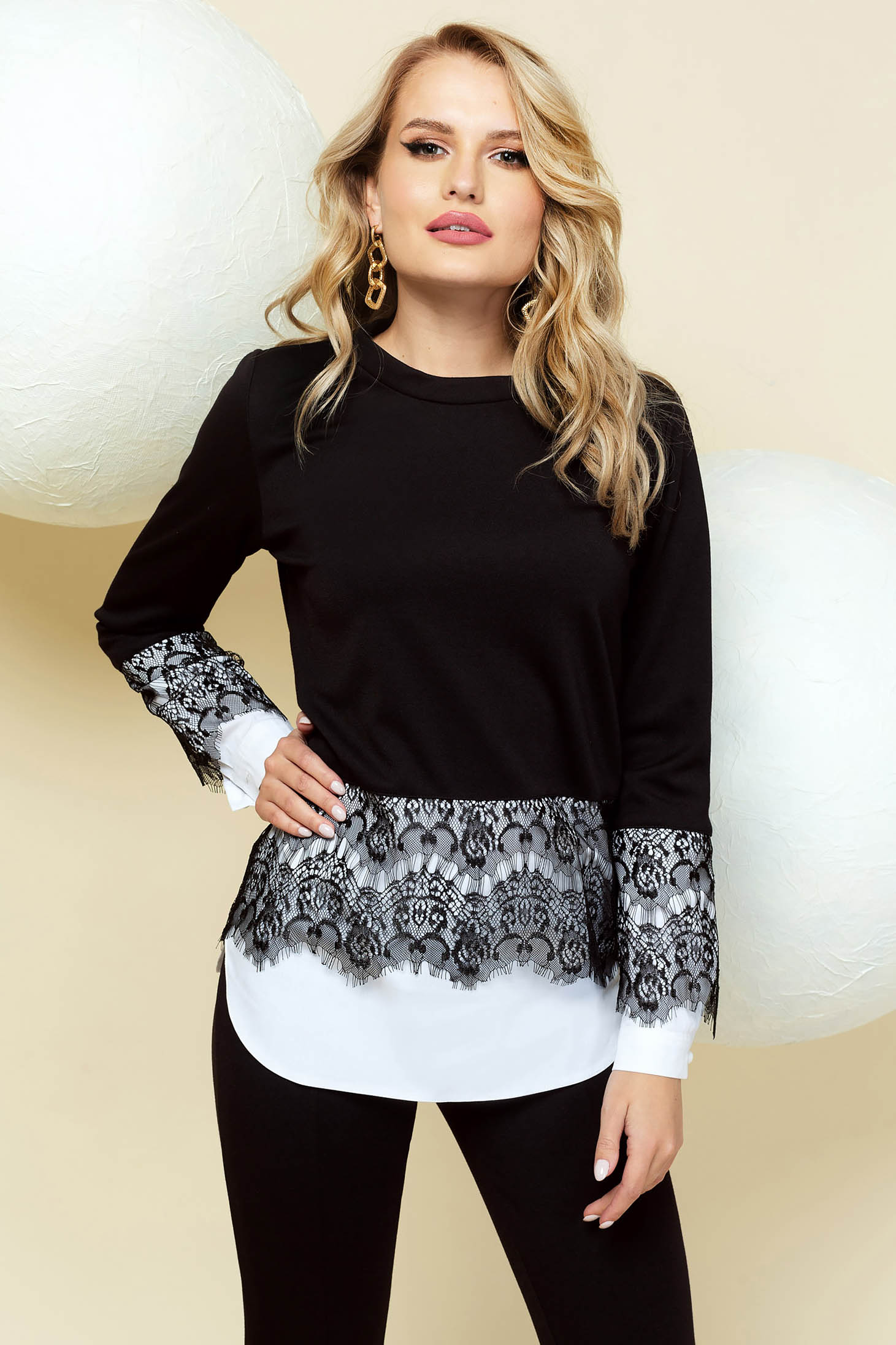 Elegant black women`s blouse flared with lace details