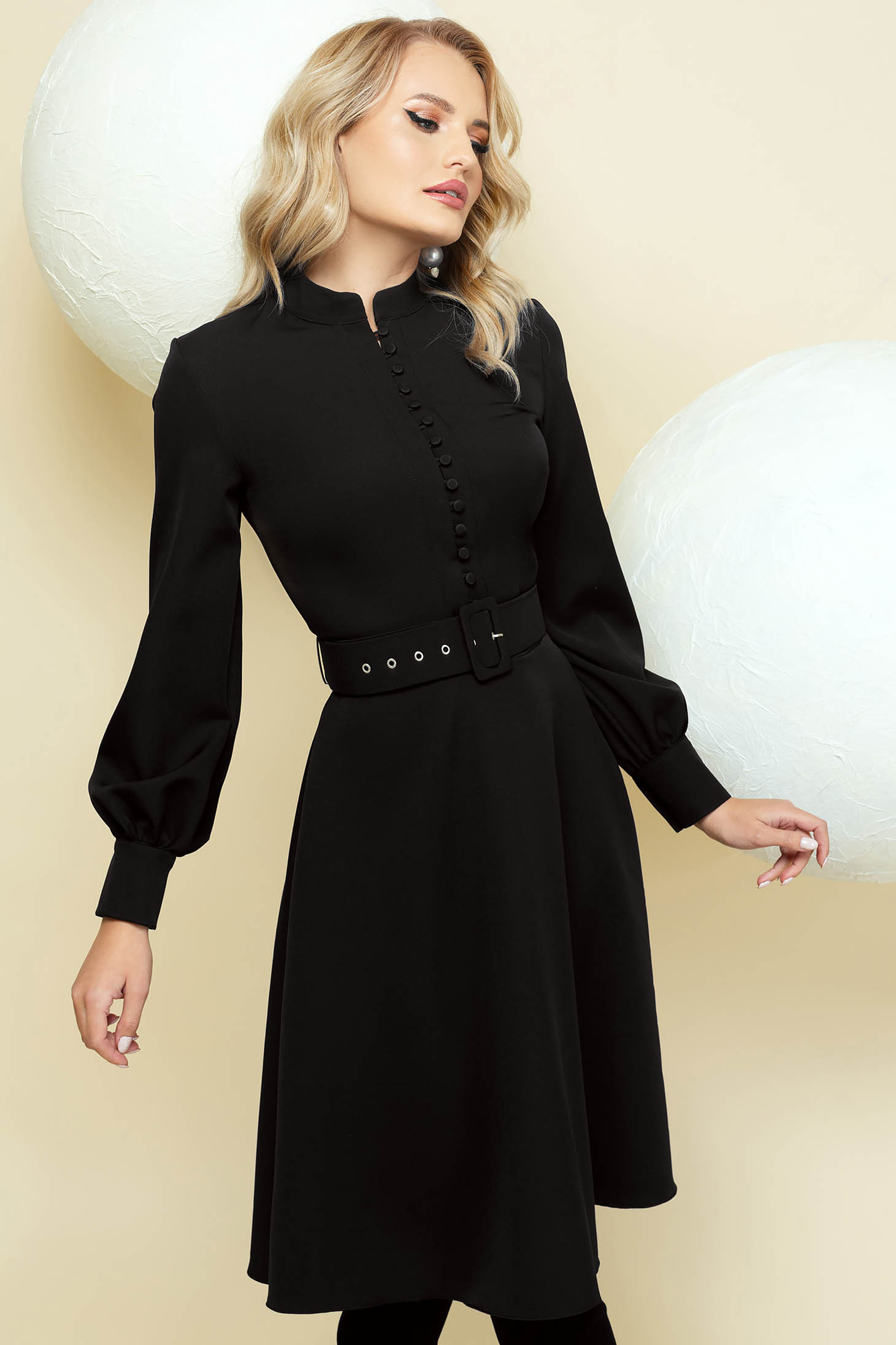 Elegant black cloche dress with puffed sleeves accessorized with belt