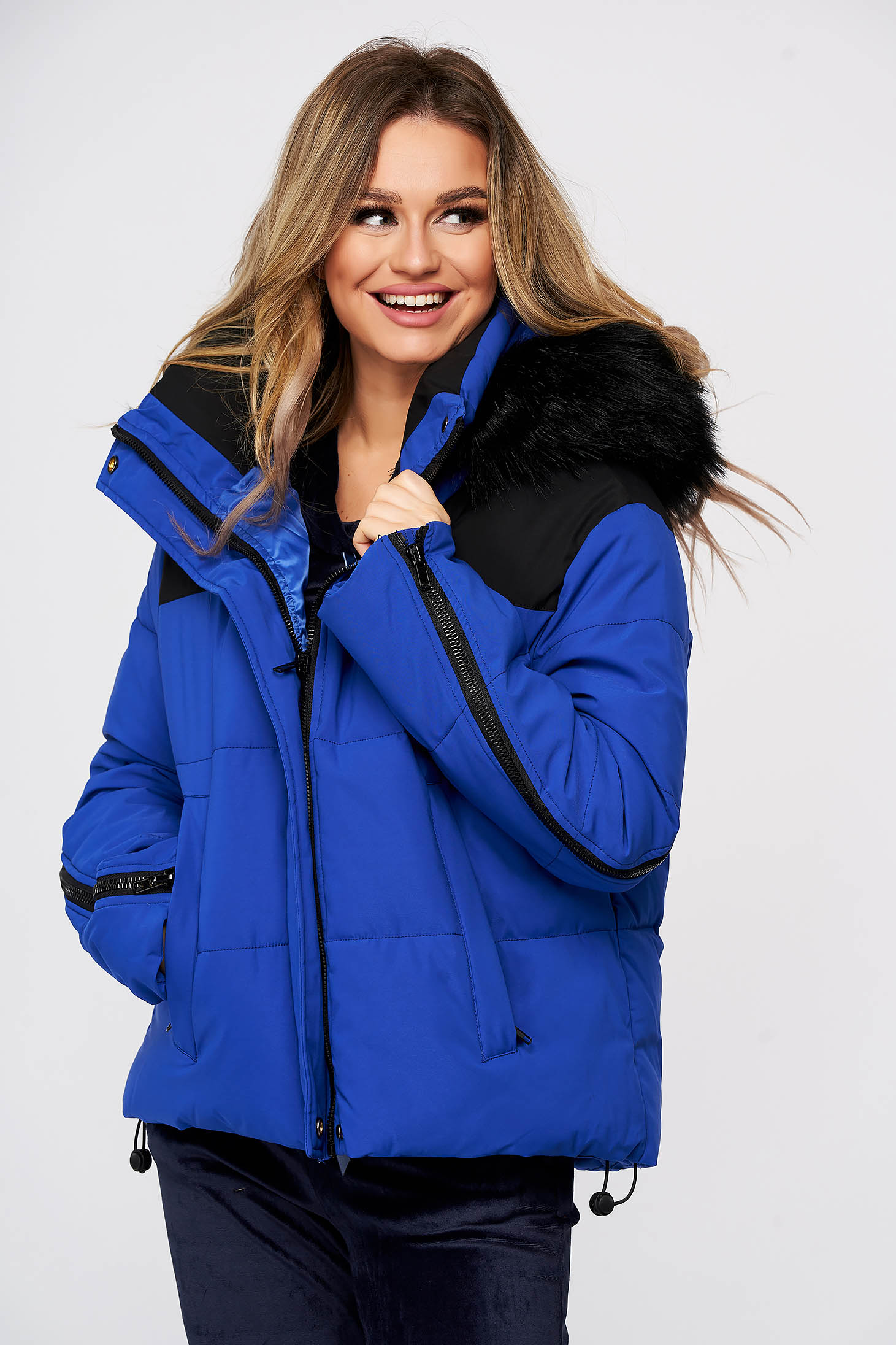 Blue casual jacket with easy cut with undetachable hood from ecological fur from slicker