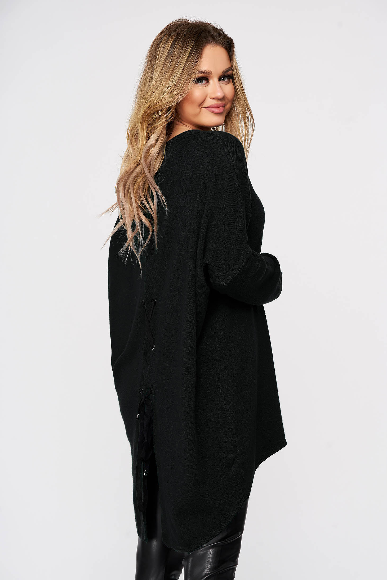 Black women`s blouse from elastic and fine fabric knitted with easy cut ribbon fastening back slit