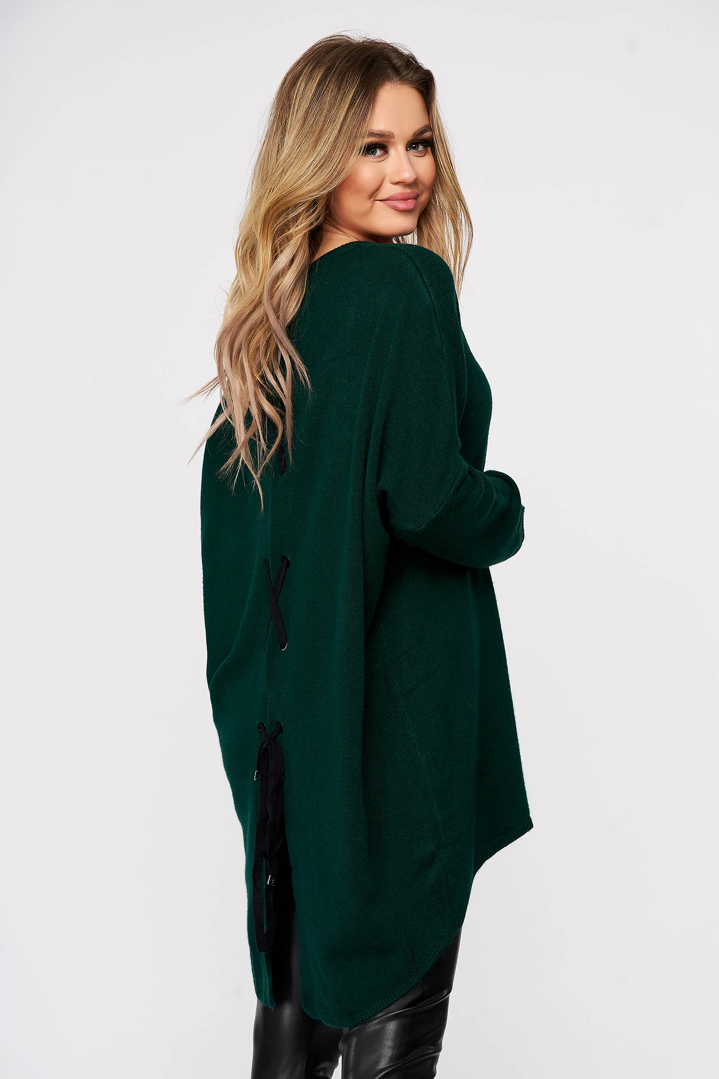 Green women`s blouse from elastic and fine fabric knitted with easy cut ribbon fastening back slit