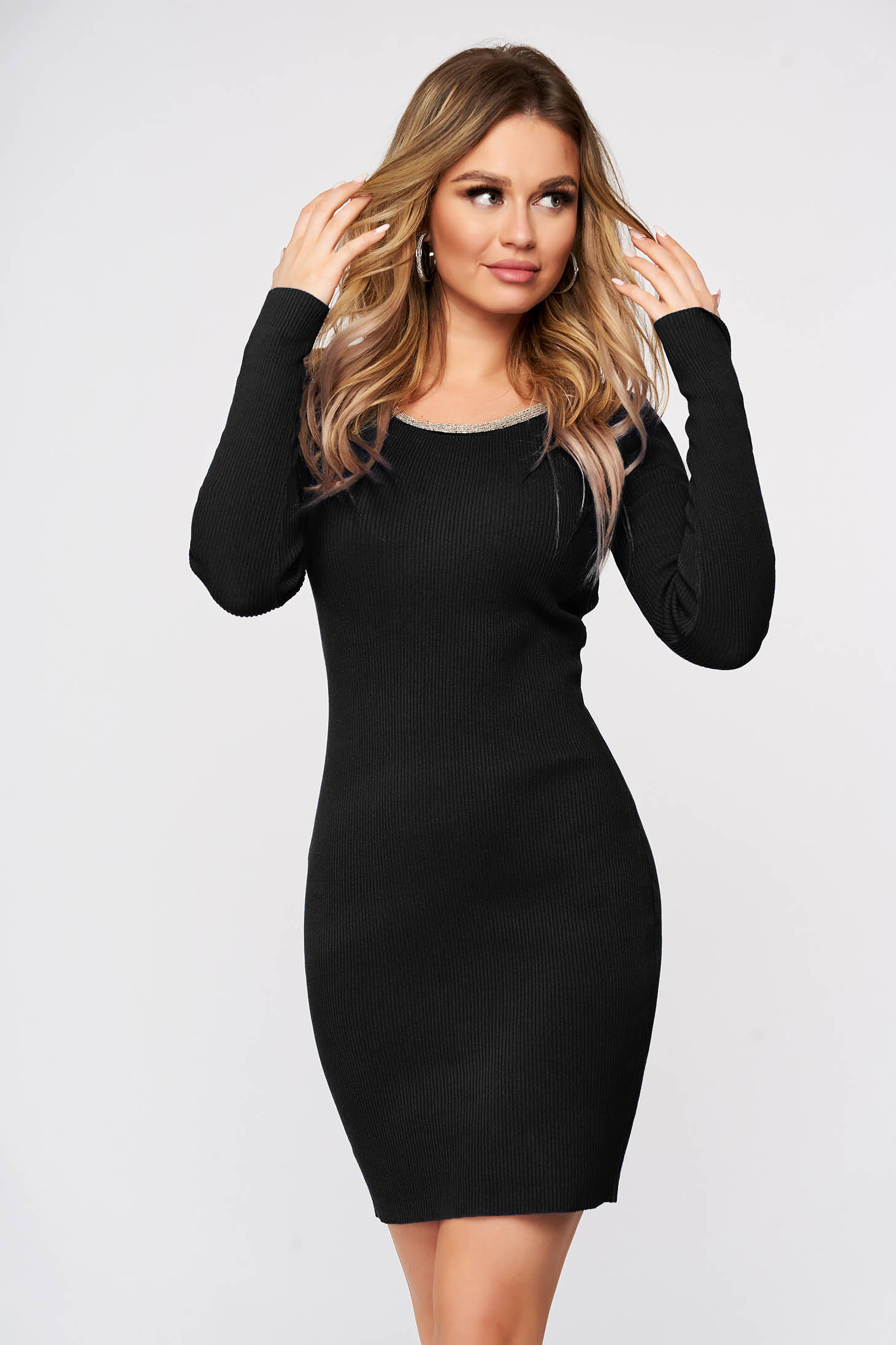 Black dress from elastic fabric from striped fabric knitted with metal accessories neckline
