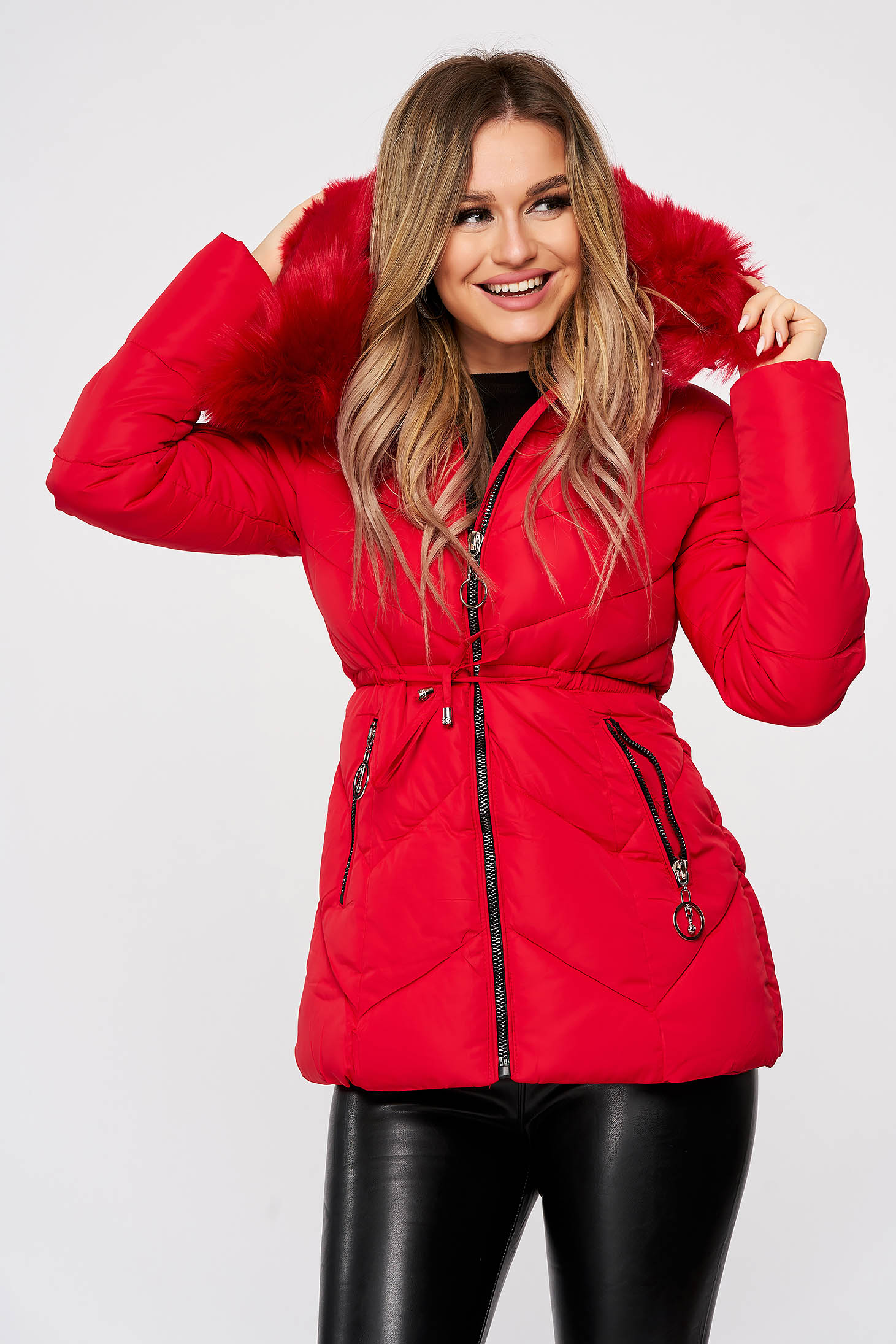 Red jacket from slicker is fastened around the waist with a ribbon detachable hood with furry hood with zipper details pockets