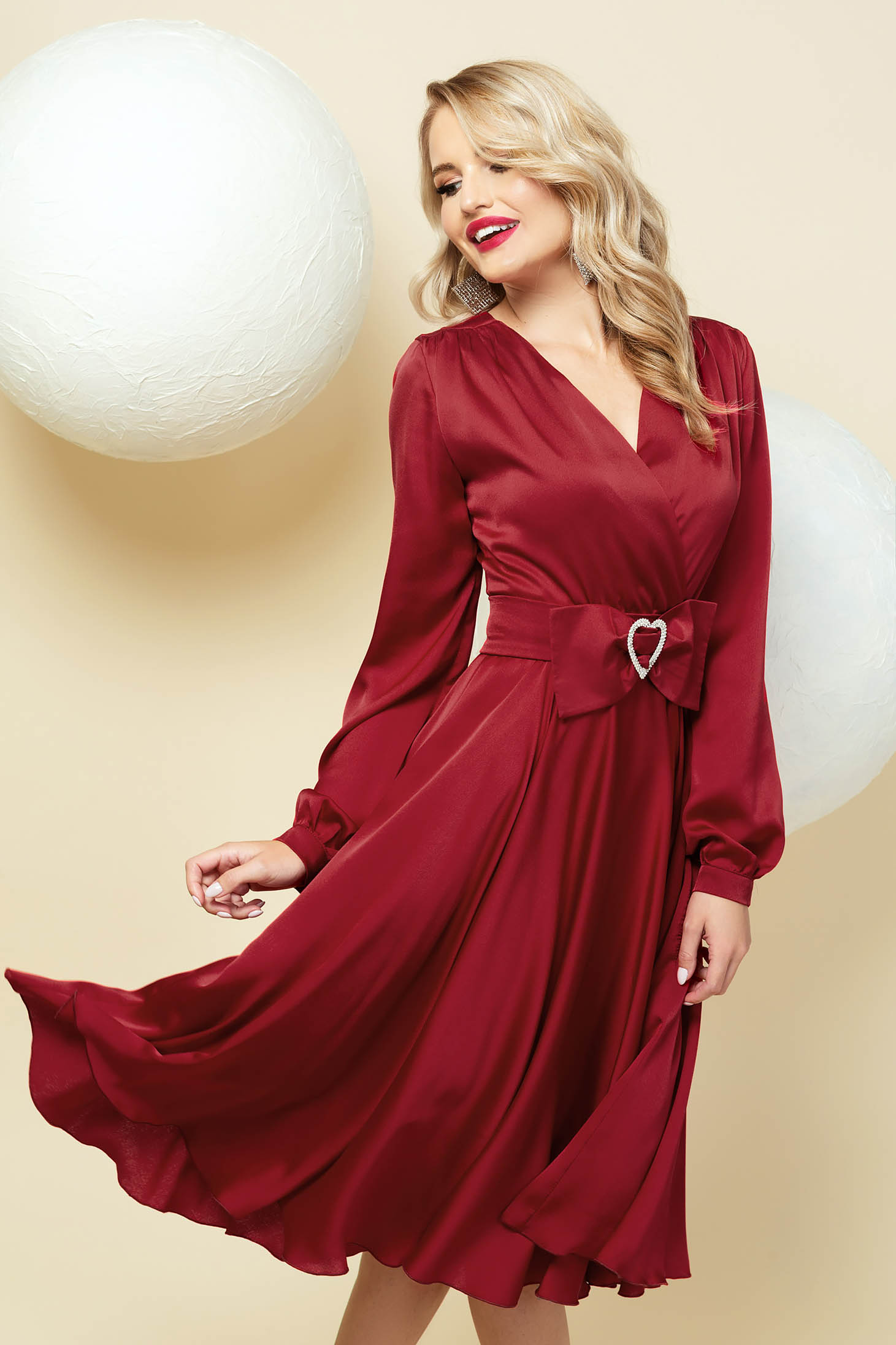 Cloche burgundy dress wrap over front with v-neckline accessorized with belt