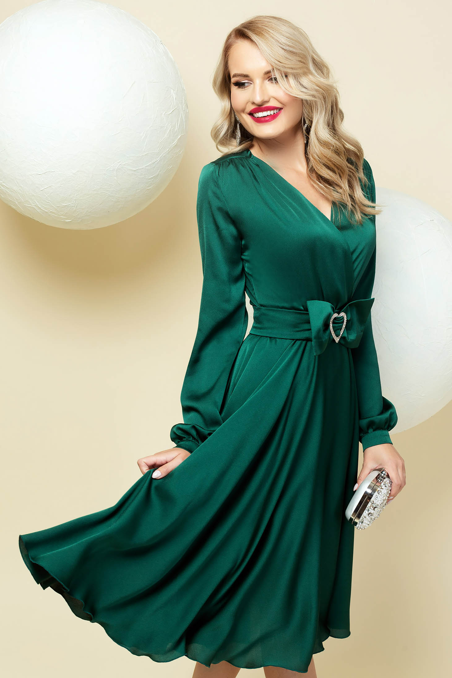 Cloche green dress wrap over front with v-neckline accessorized with belt