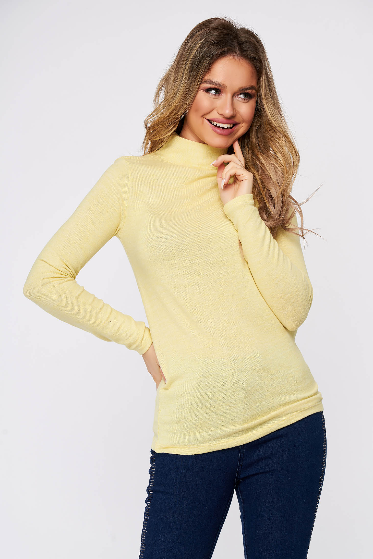 Yellow women`s blouse cotton with turtle neck from elastic and fine fabric soft fabric