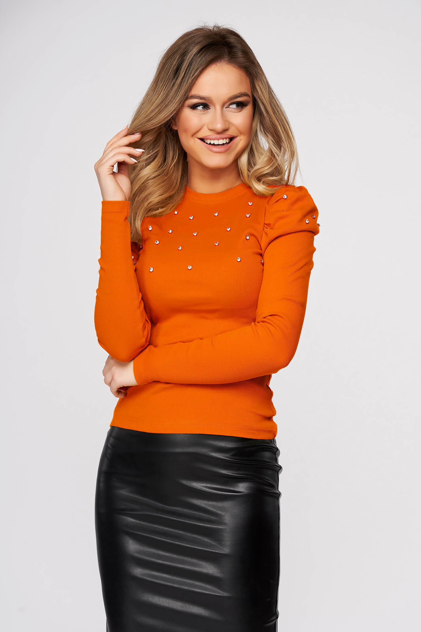 Orange women`s blouse tented with crystal embellished details from striped fabric casual high shoulders