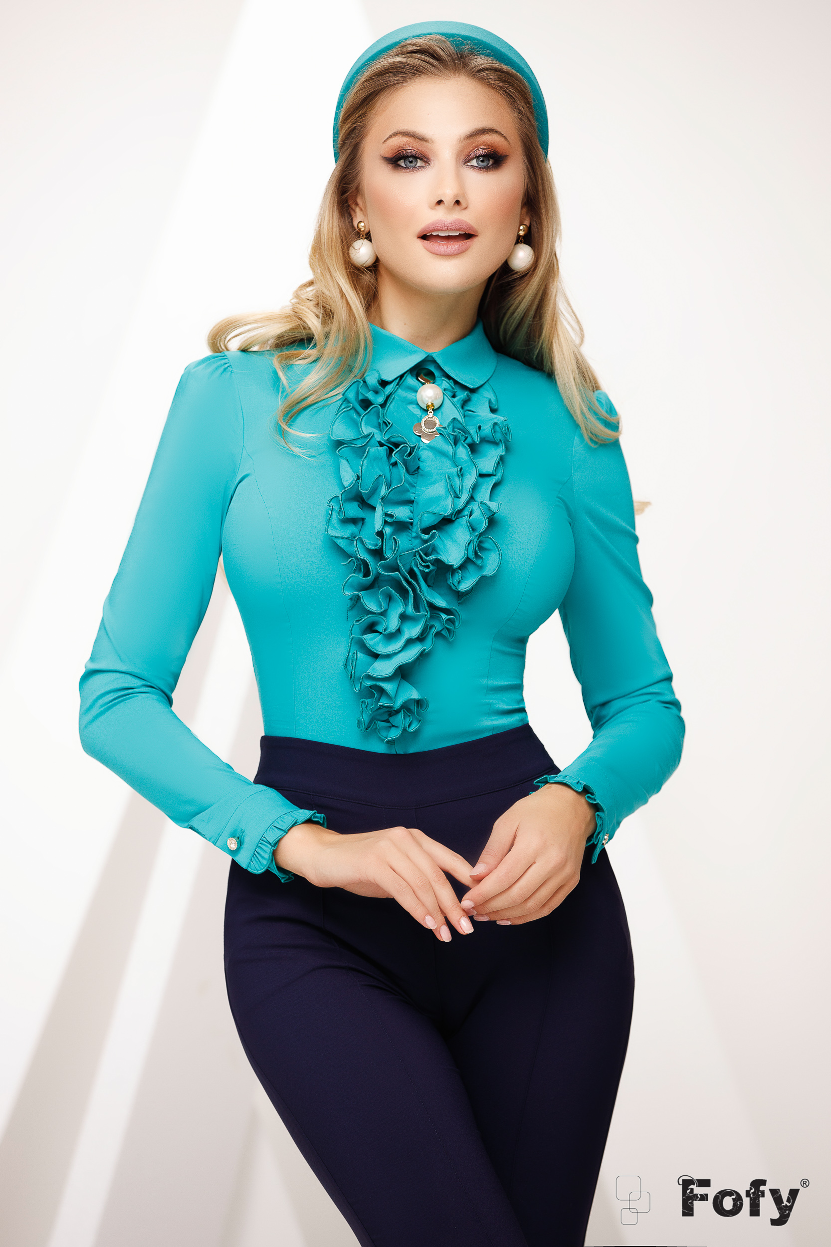 Women`s shirt green office with collar accessorized with breastpin with ruffle details