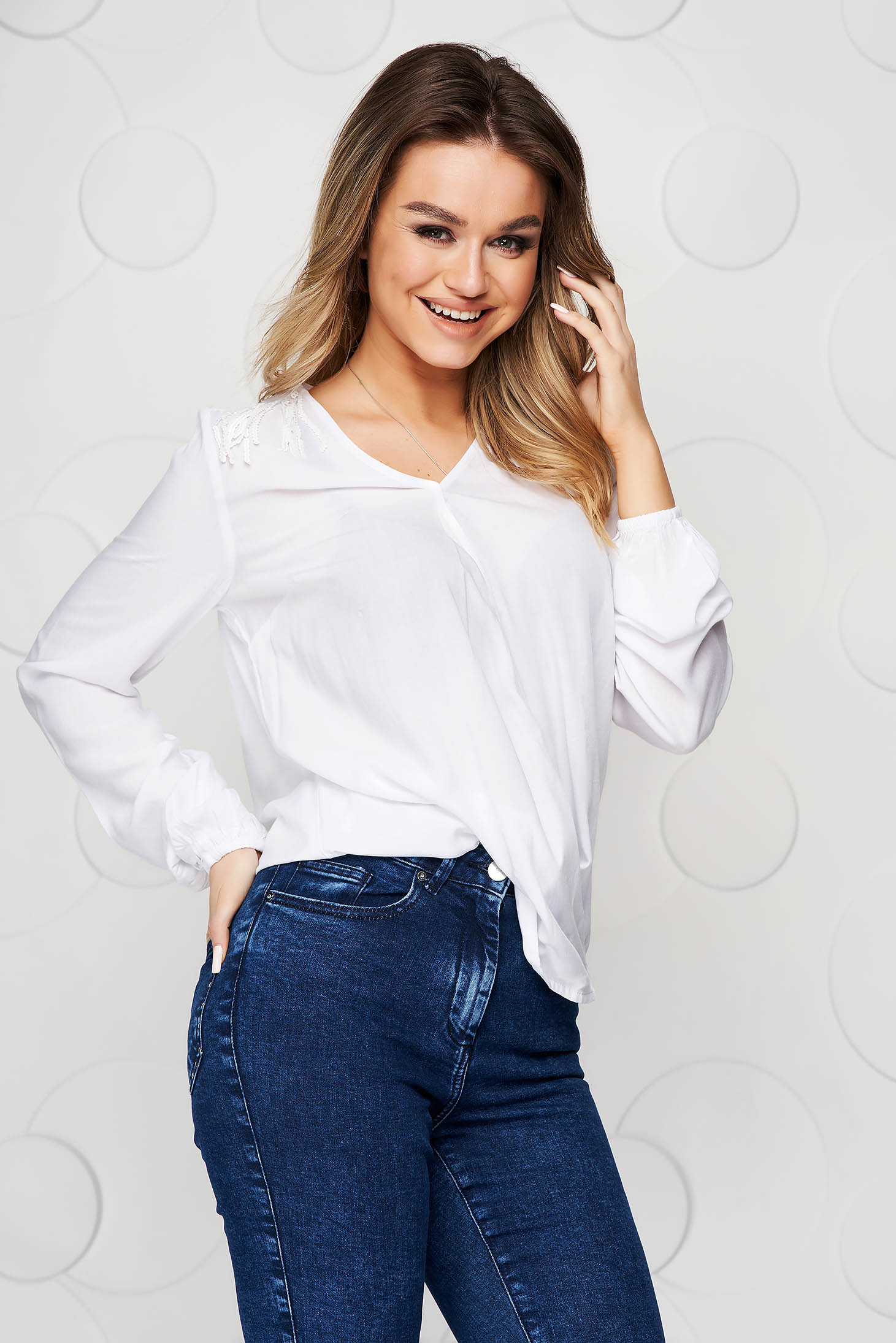 White women`s blouse loose fit with v-neckline with sequin embellished details with fringes