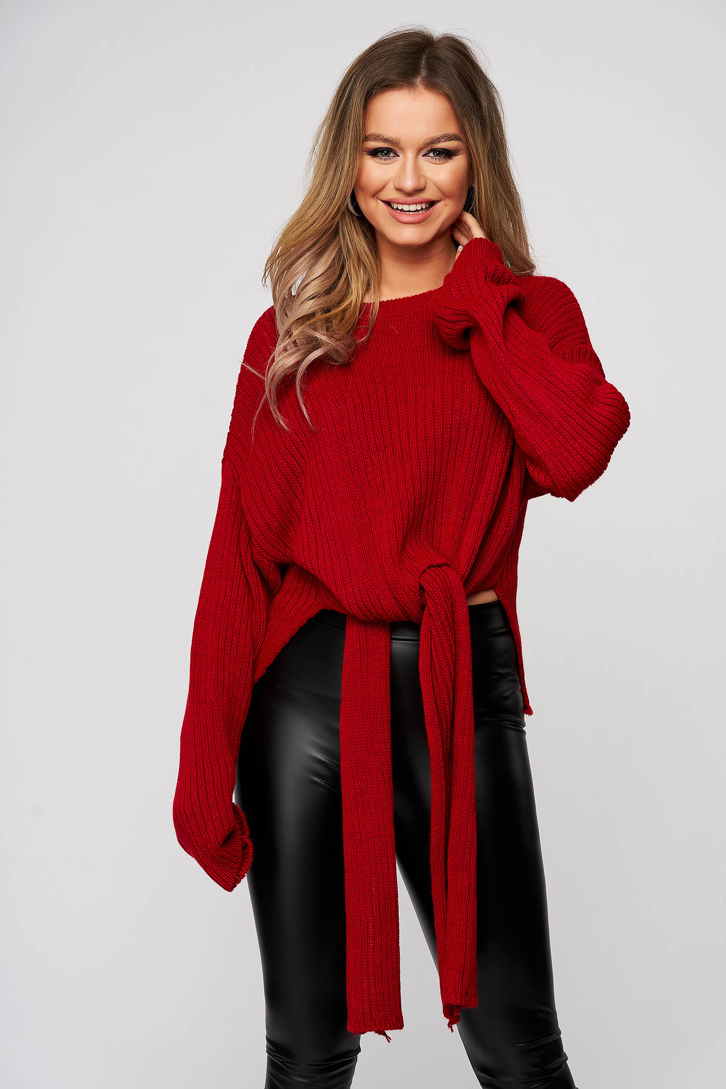 Red women`s blouse from elastic and fine fabric from striped fabric casual