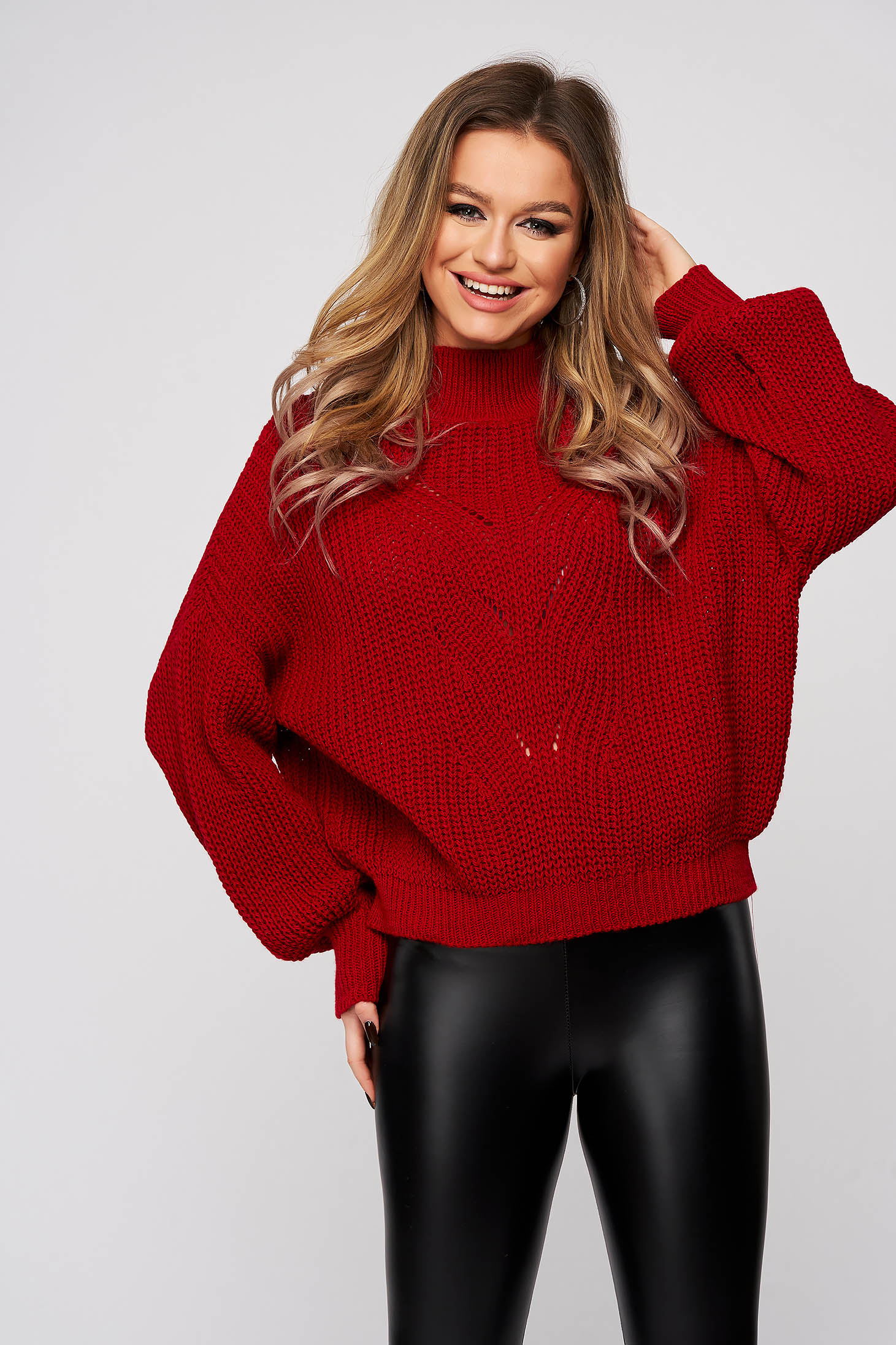 Red sweater knitted with puffed sleeves flared slightly transparent fabric