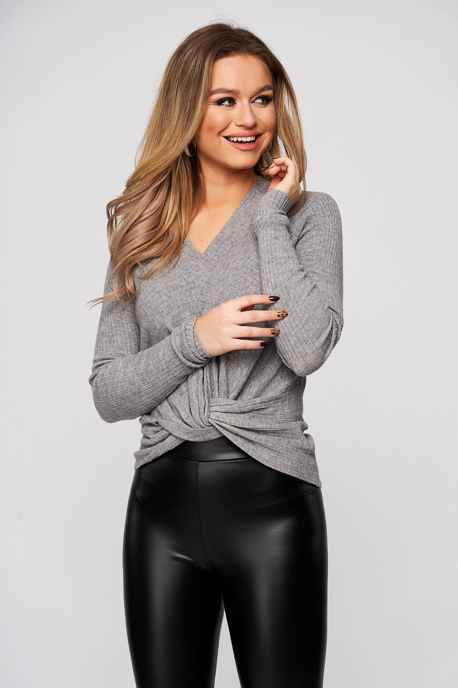 Grey women`s blouse with v-neckline from striped fabric flared