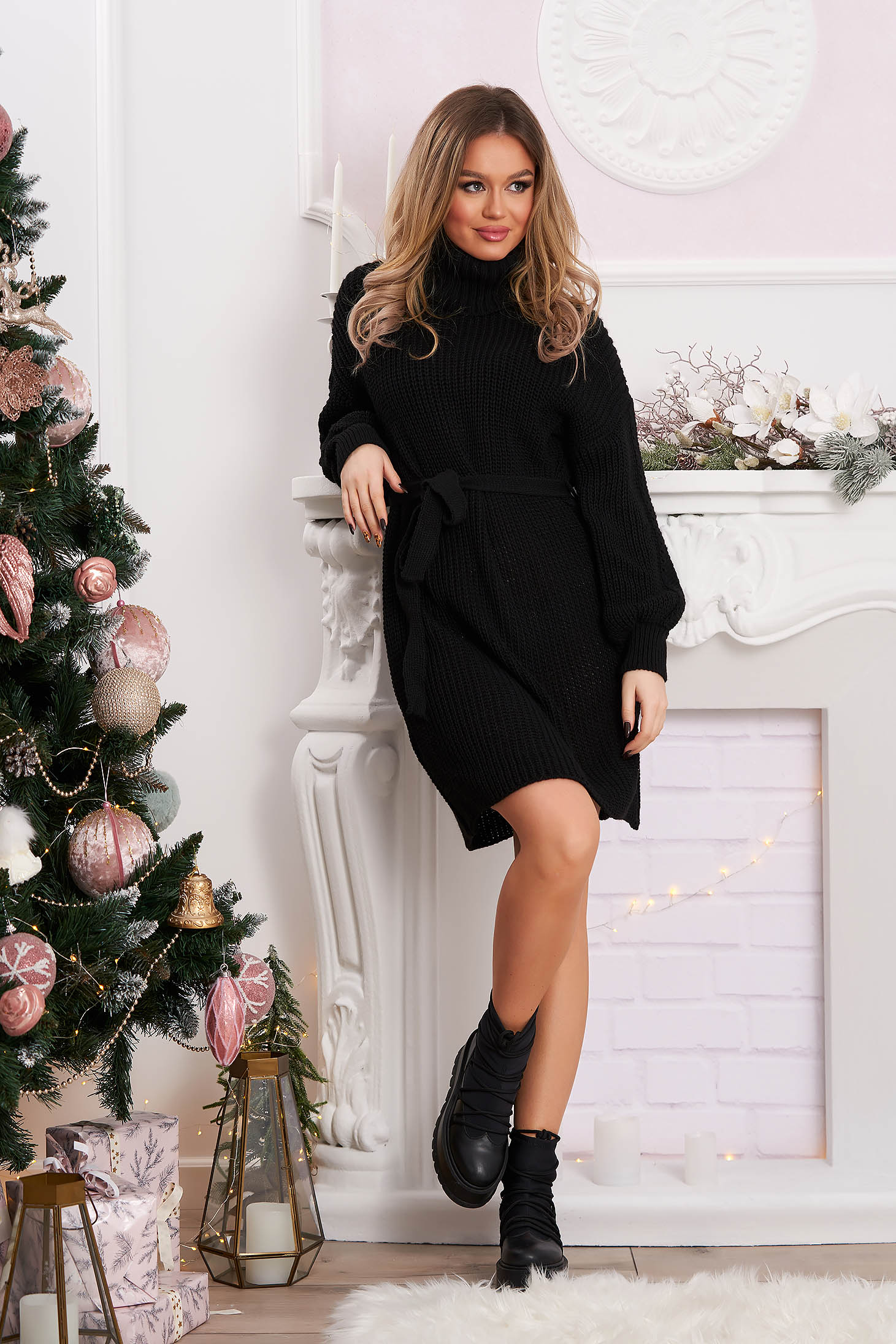 Black dress knitted from elastic fabric from striped fabric accessorized with tied waistband flared