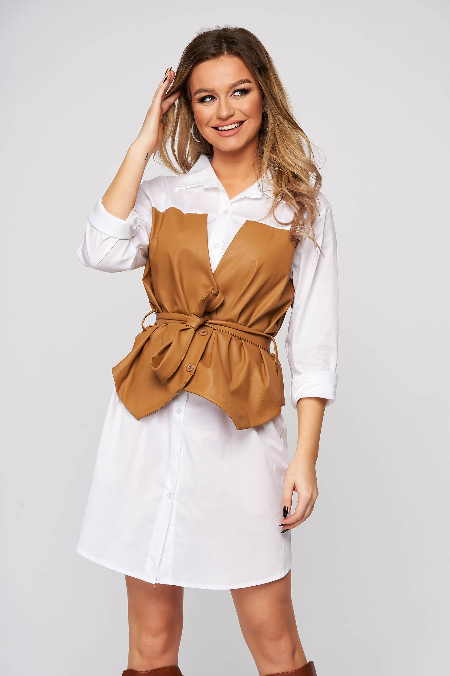White dress shirt dress accessorized with tied waistband with faux leather details