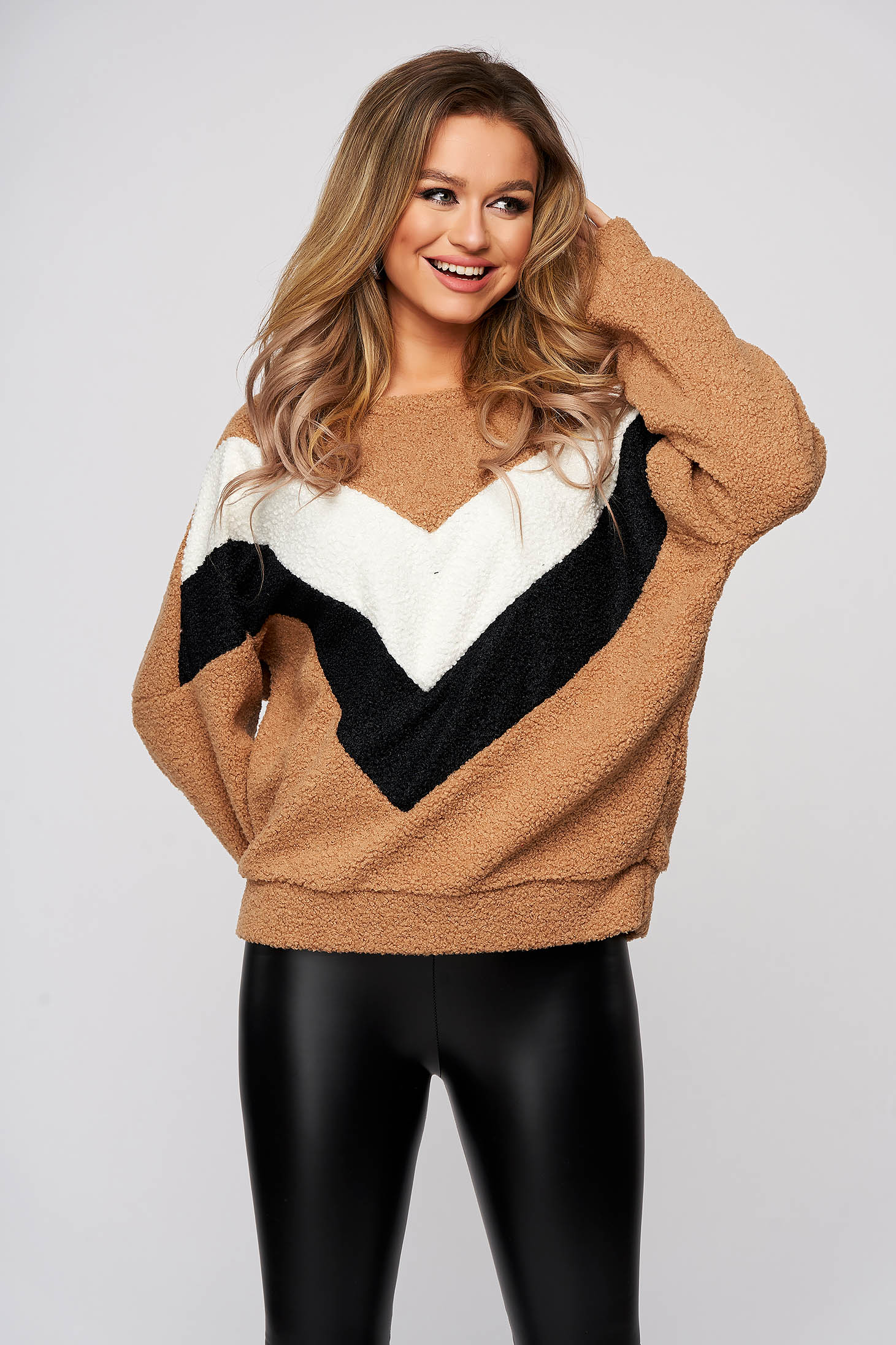 Brown sweater from elastic and fine fabric with rounded cleavage flared from fluffy fabric