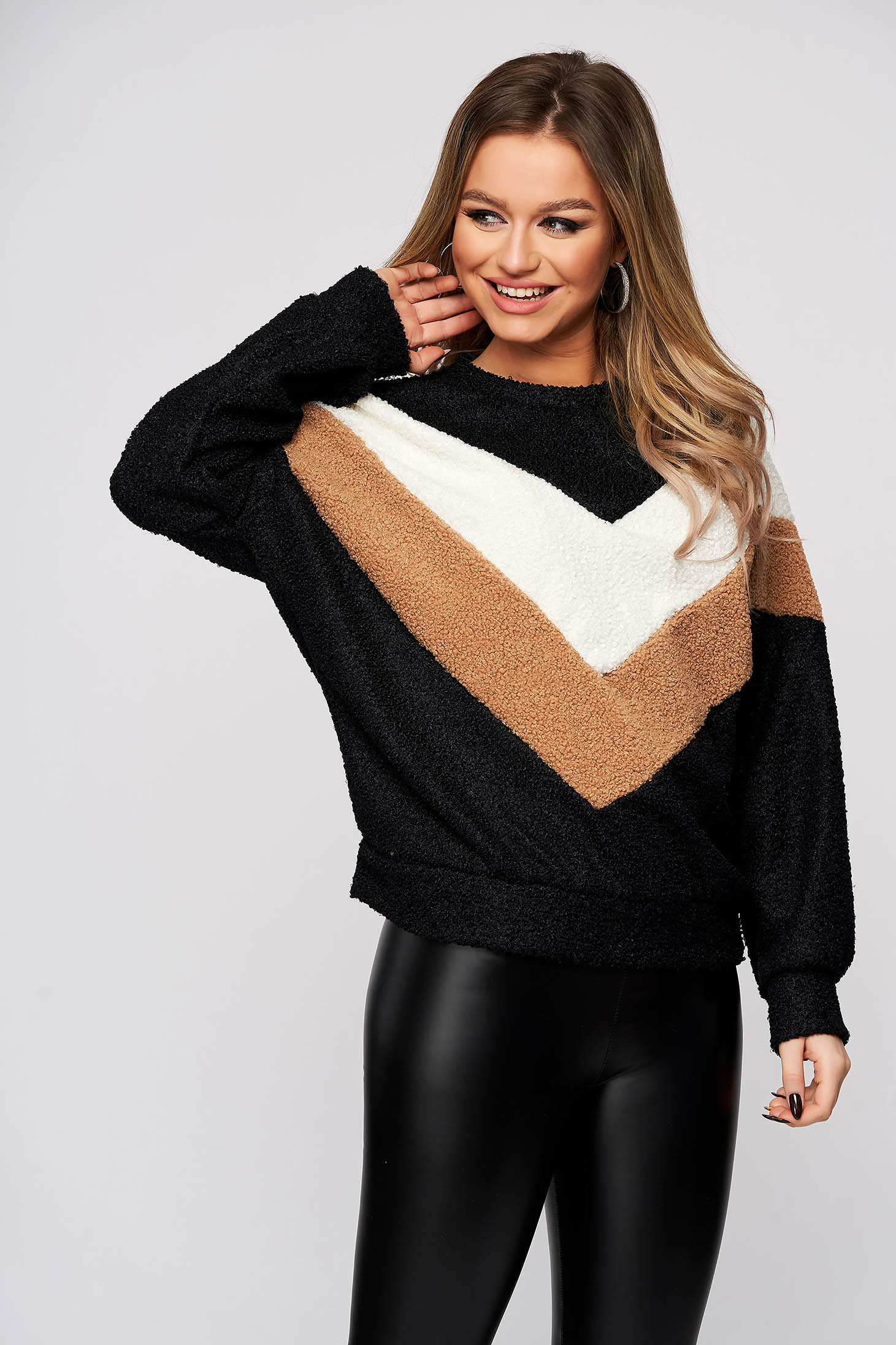 Black sweater from elastic and fine fabric with rounded cleavage flared from fluffy fabric