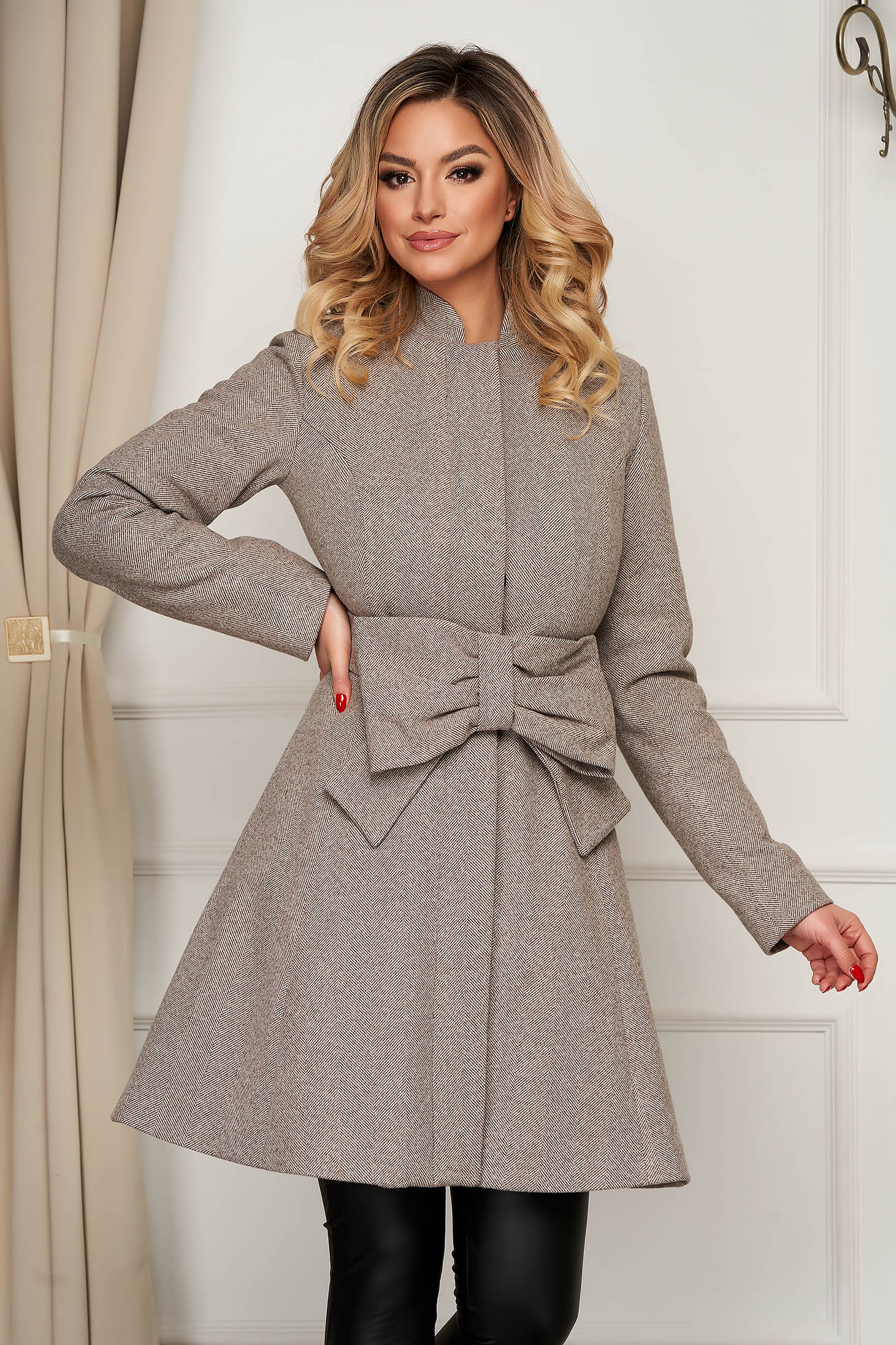 Cream coat cloche elegant accessorized with tied waistband with pockets
