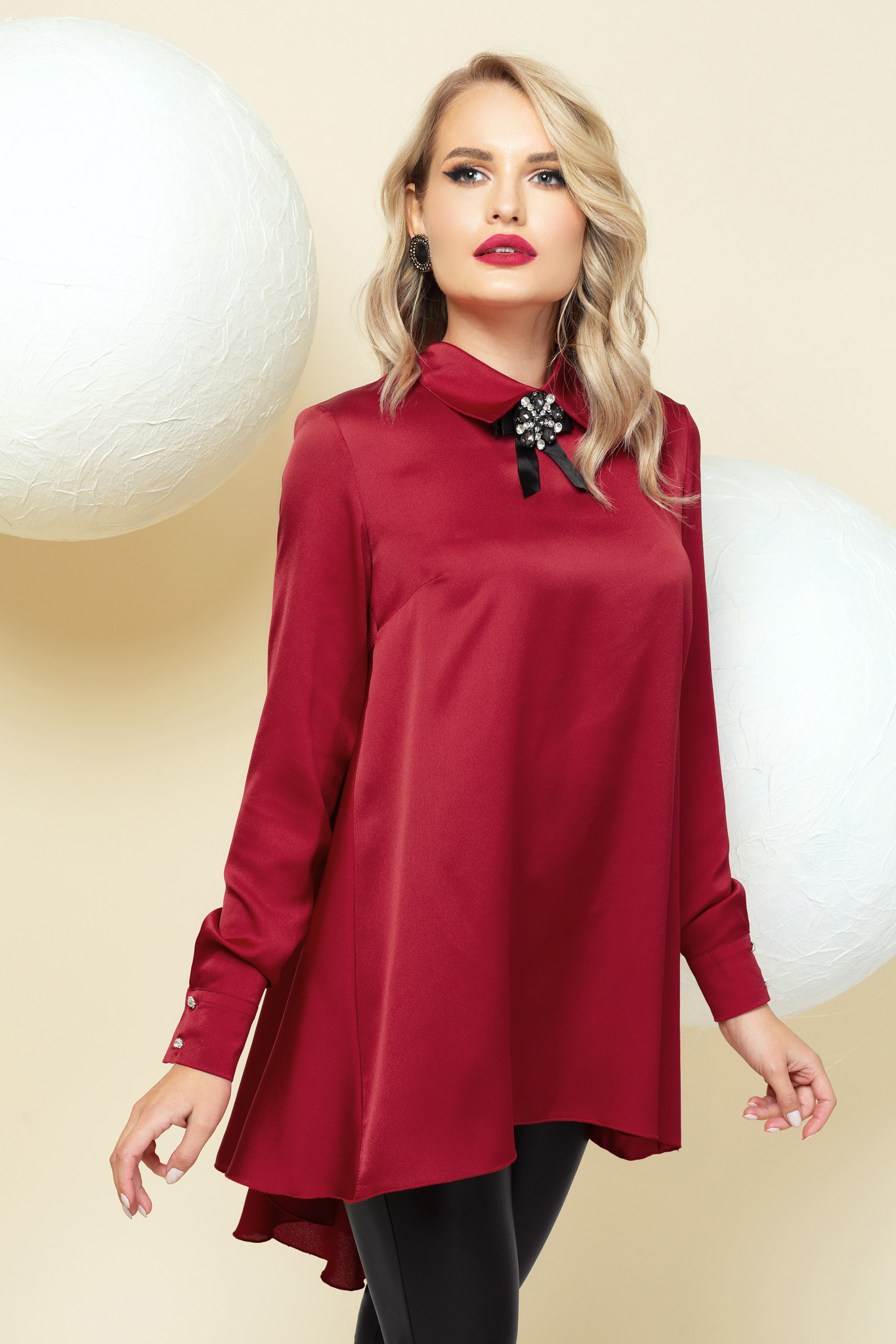 Women`s blouse red from satin occasional asymmetrical accessorized with breastpin flared
