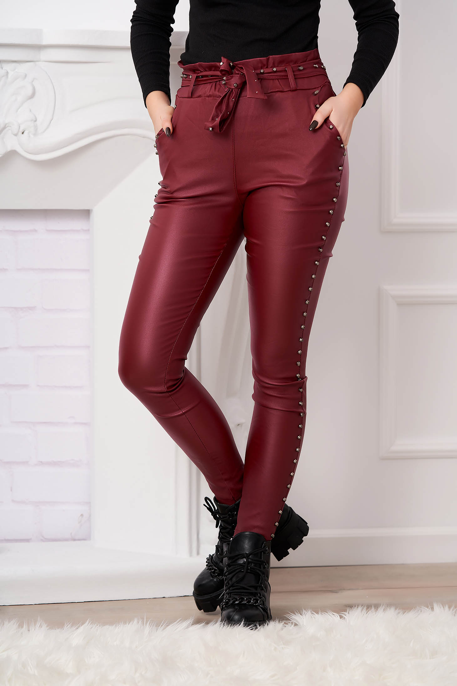 Burgundy trousers with metallic spikes from ecological leather high waisted with tented cut
