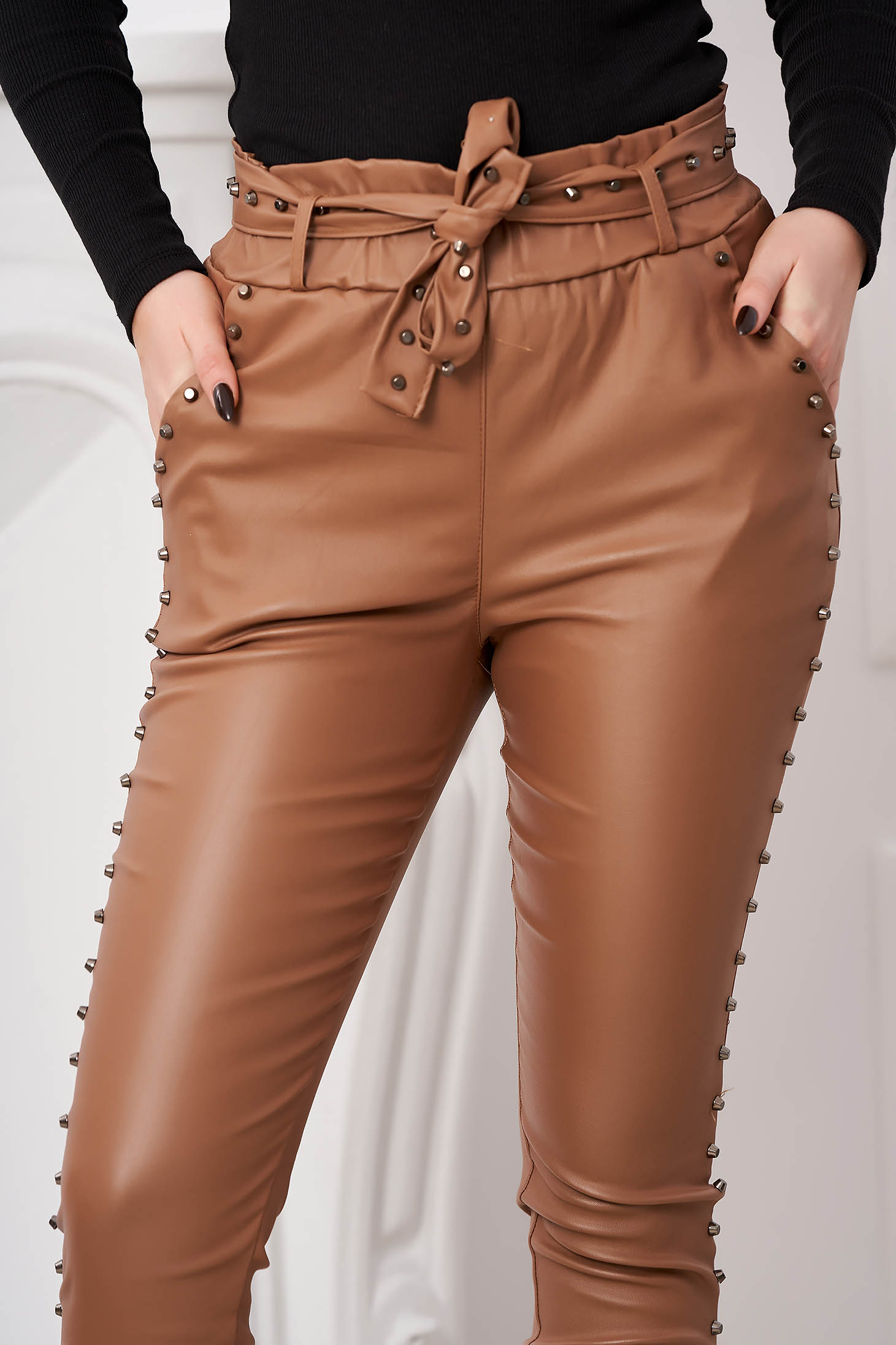 Cappuccino trousers with metallic spikes from ecological leather high waisted with tented cut