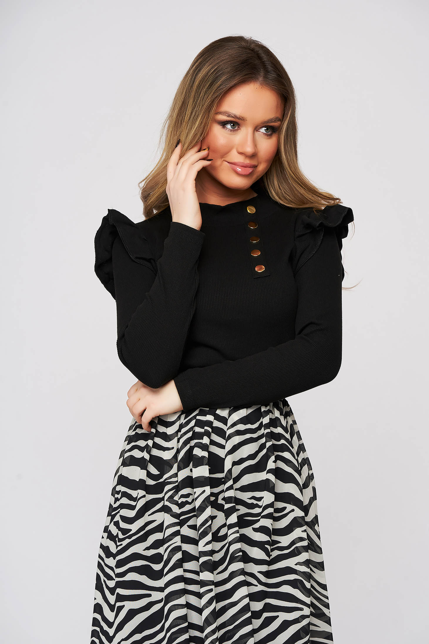 Black women`s blouse tented from striped fabric with ruffle details with turtle neck
