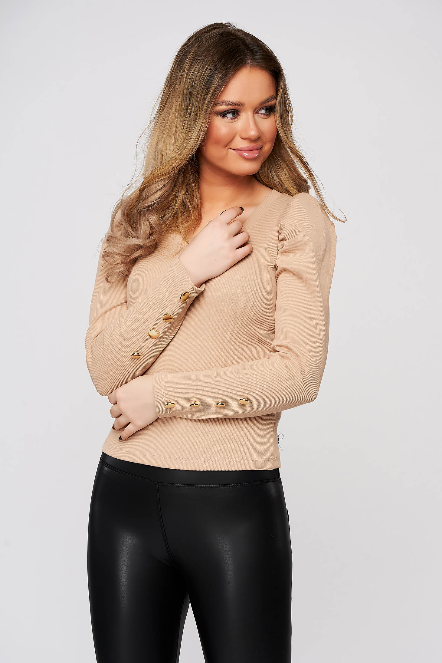 Cream women`s blouse tented high shoulders with v-neckline from striped fabric