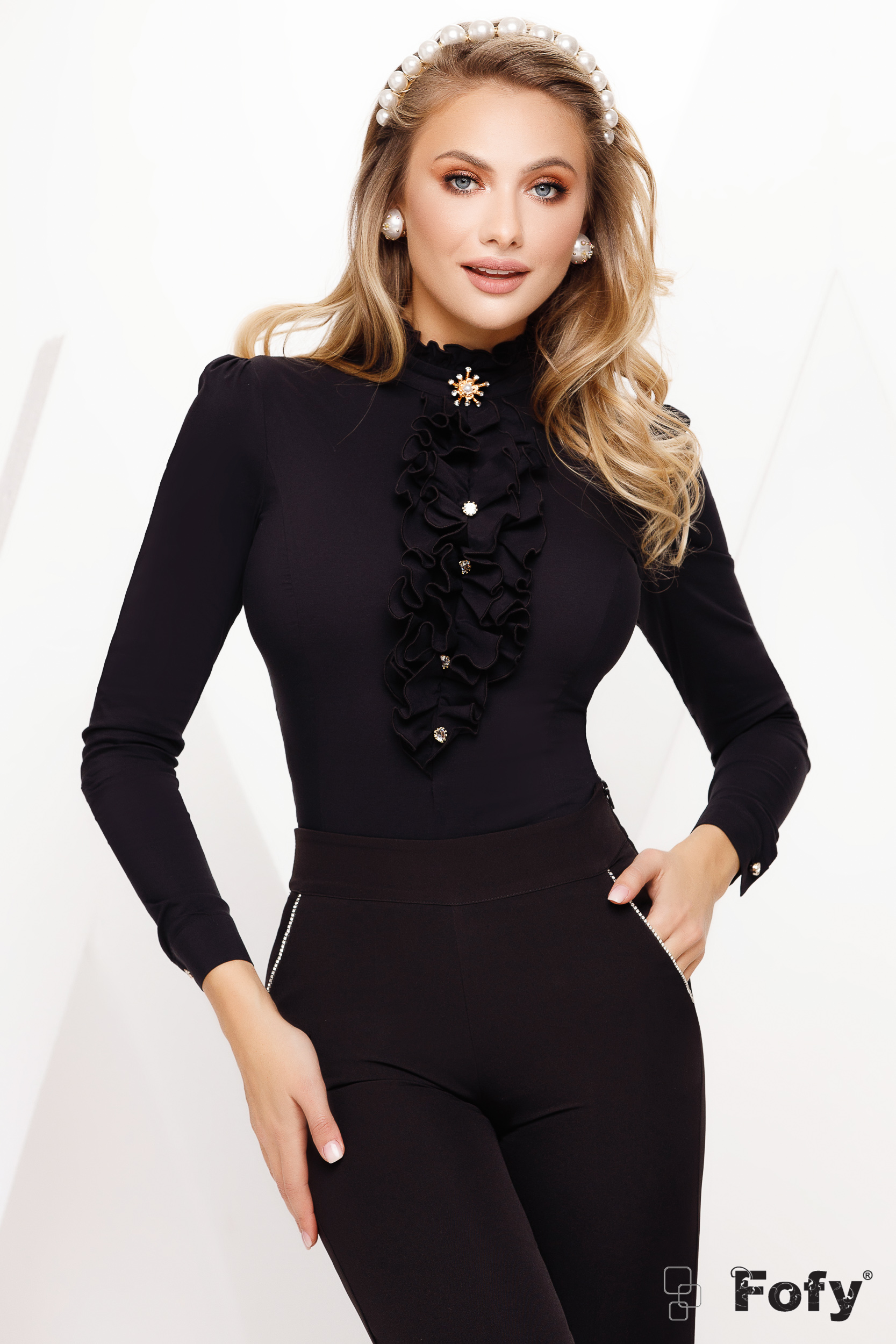 Black women`s shirt occasional with ruffles on the chest accessorized with breastpin slightly elastic cotton