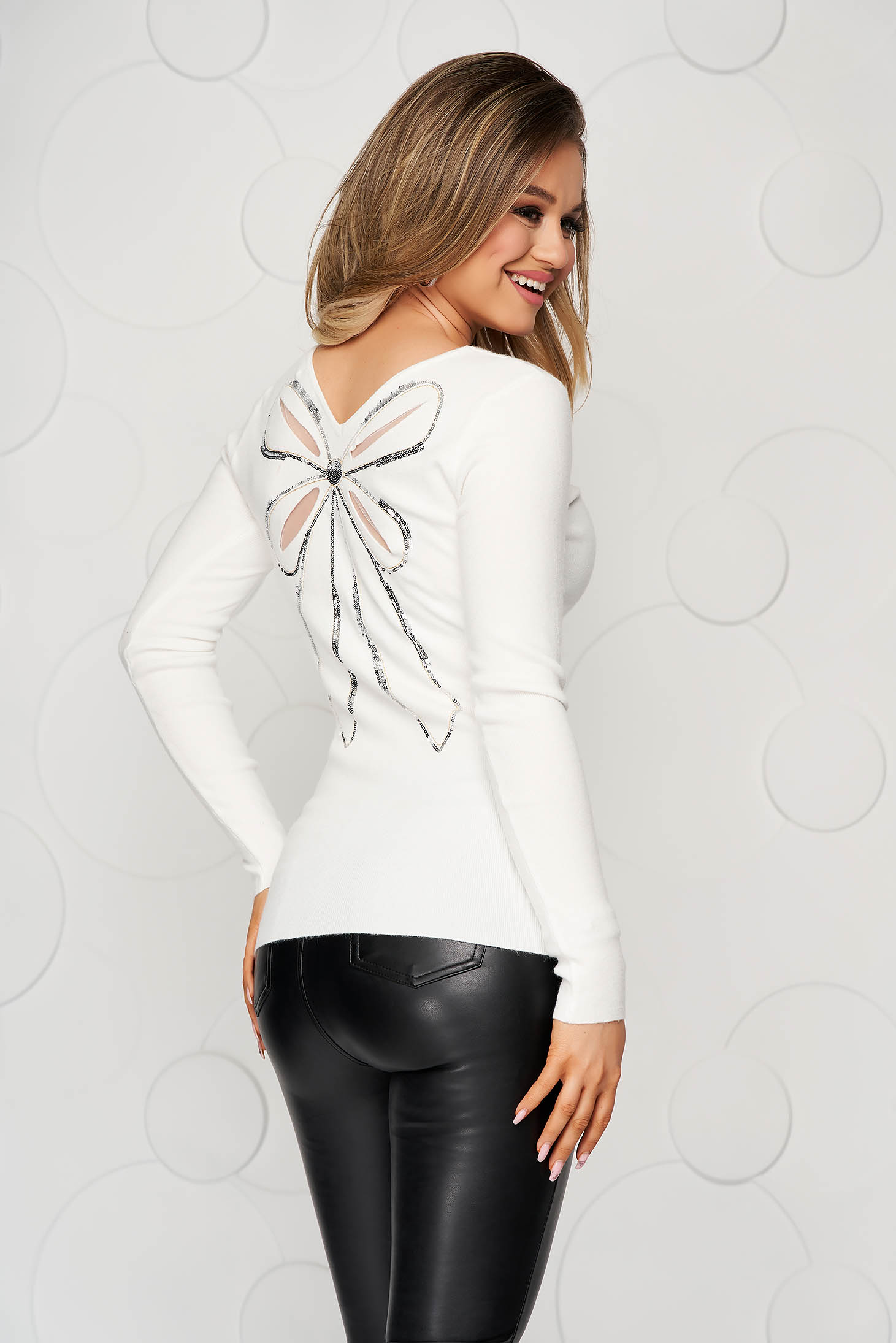 White women`s blouse from striped fabric from elastic and fine fabric knitted with sequin embellished details