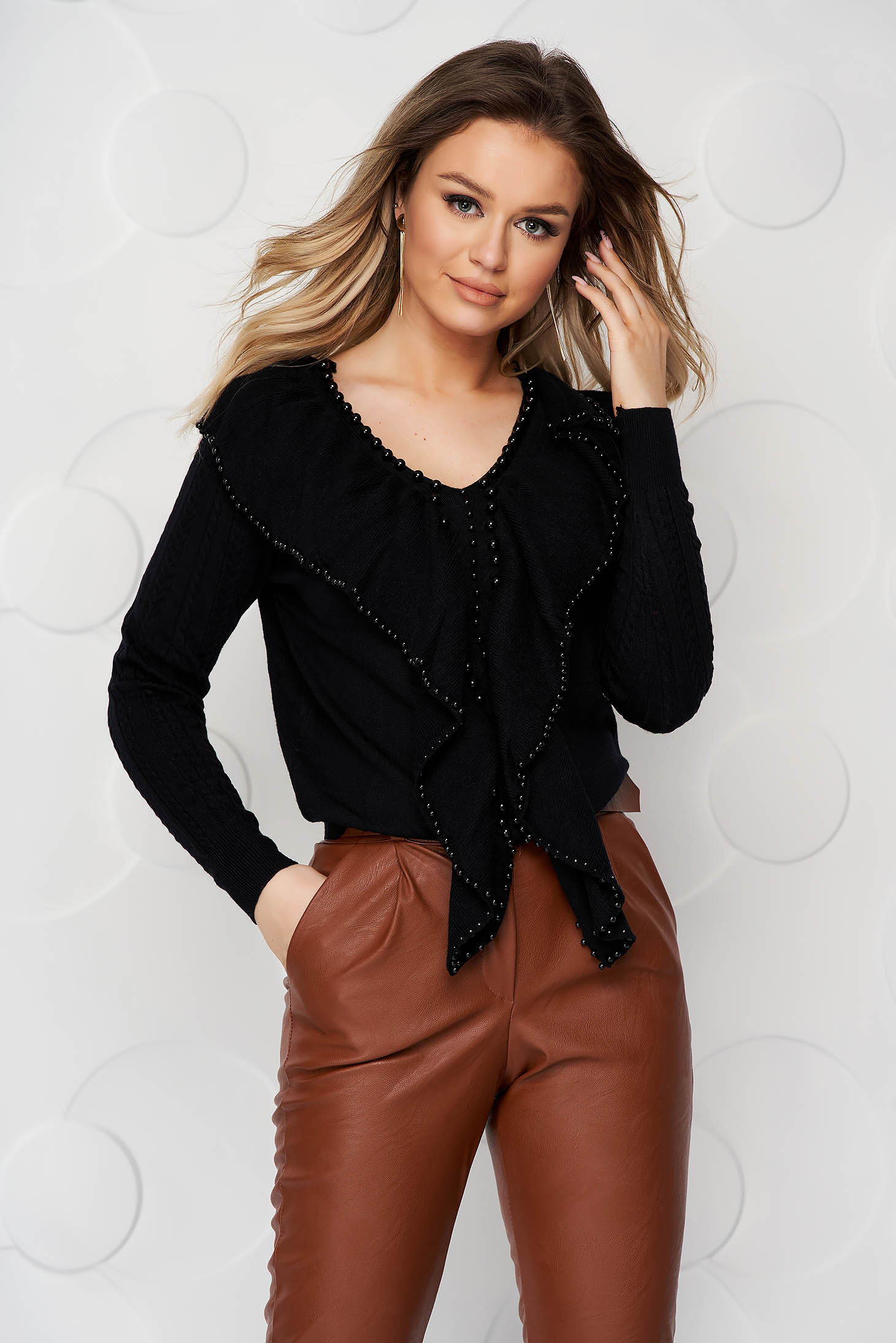 Black women`s blouse knitted from striped fabric with small beads embellished details