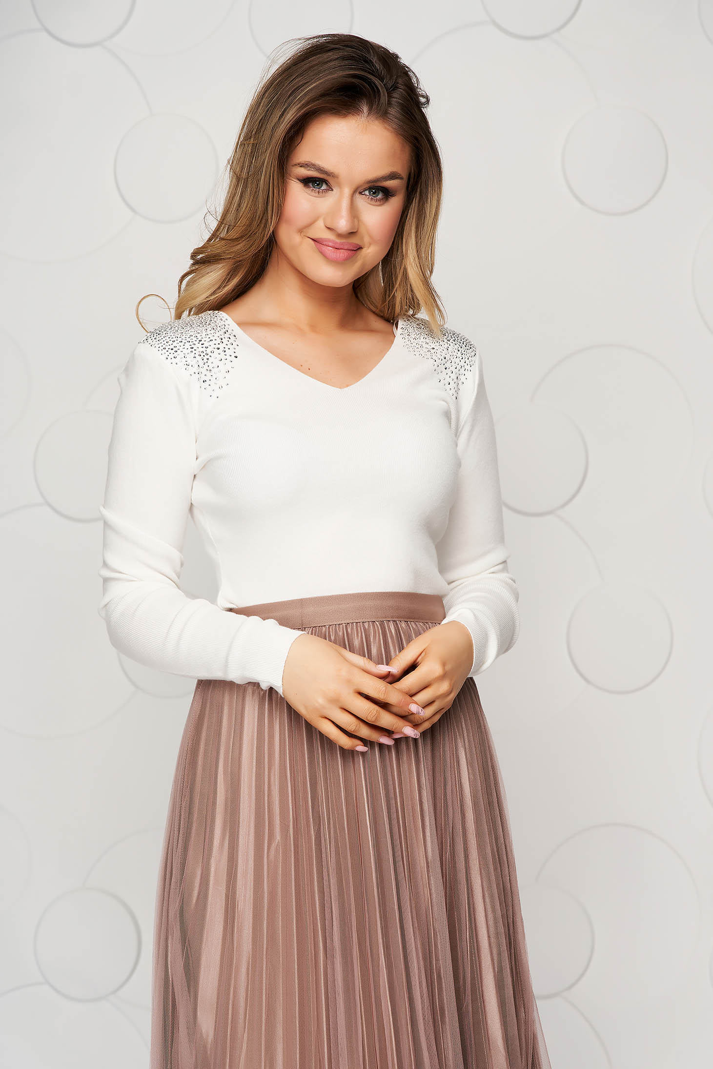 White women`s blouse knitted from elastic and fine fabric from striped fabric with padded shoulders