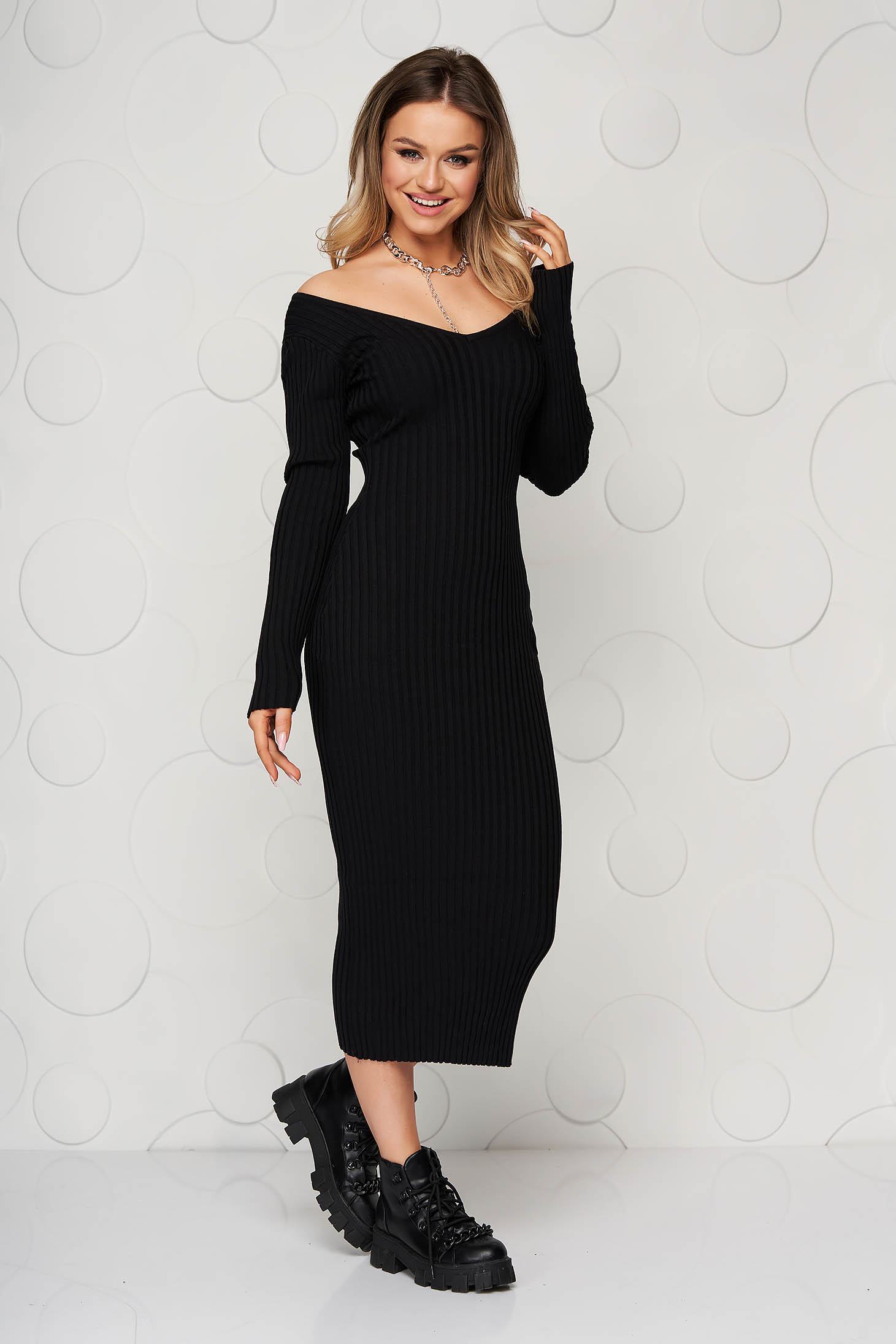 Black casual pencil knitted dress from elastic and fine fabric with deep cleavage