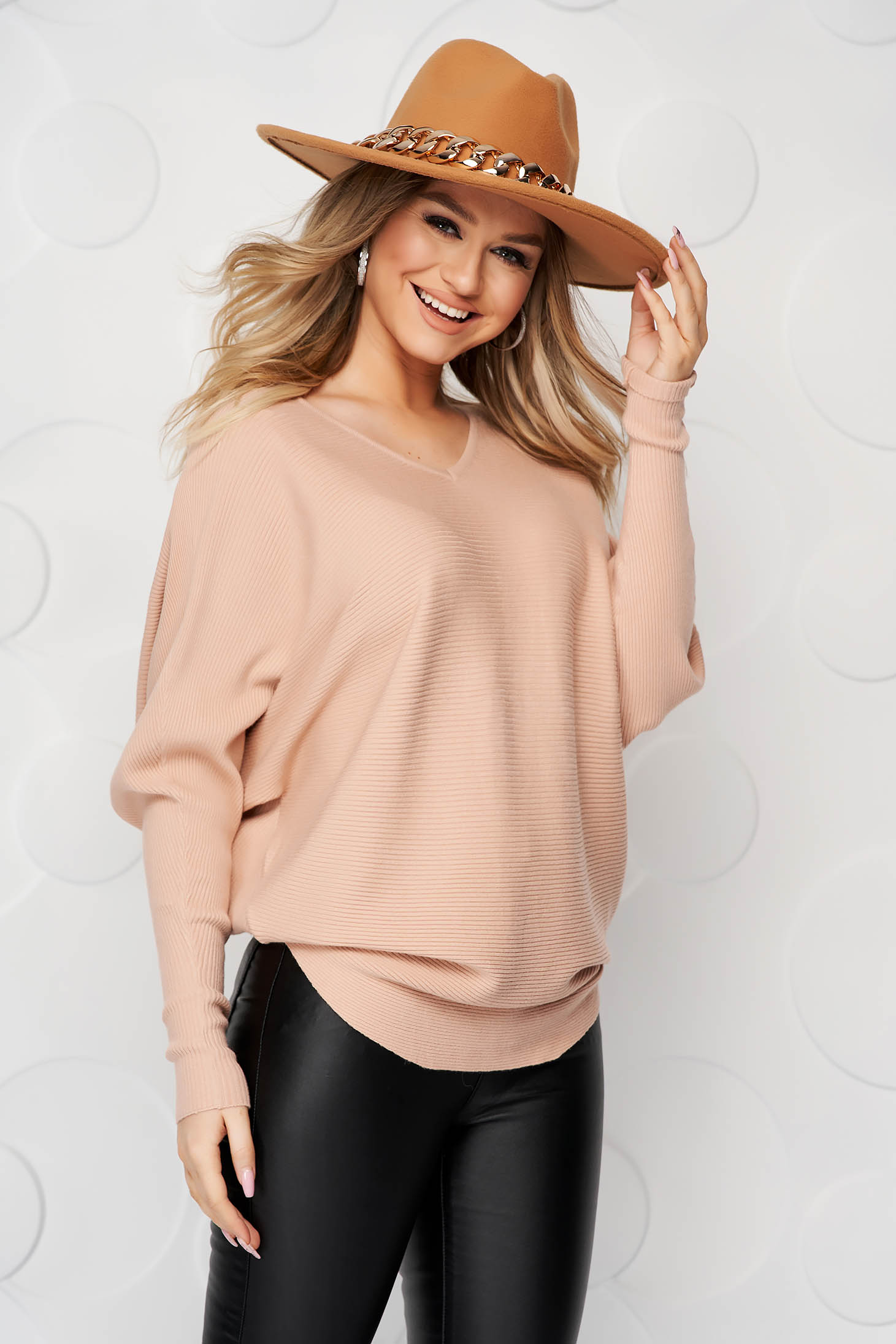 Women`s blouse cream casual knitted from striped fabric from elastic and fine fabric loose fit bow accessory