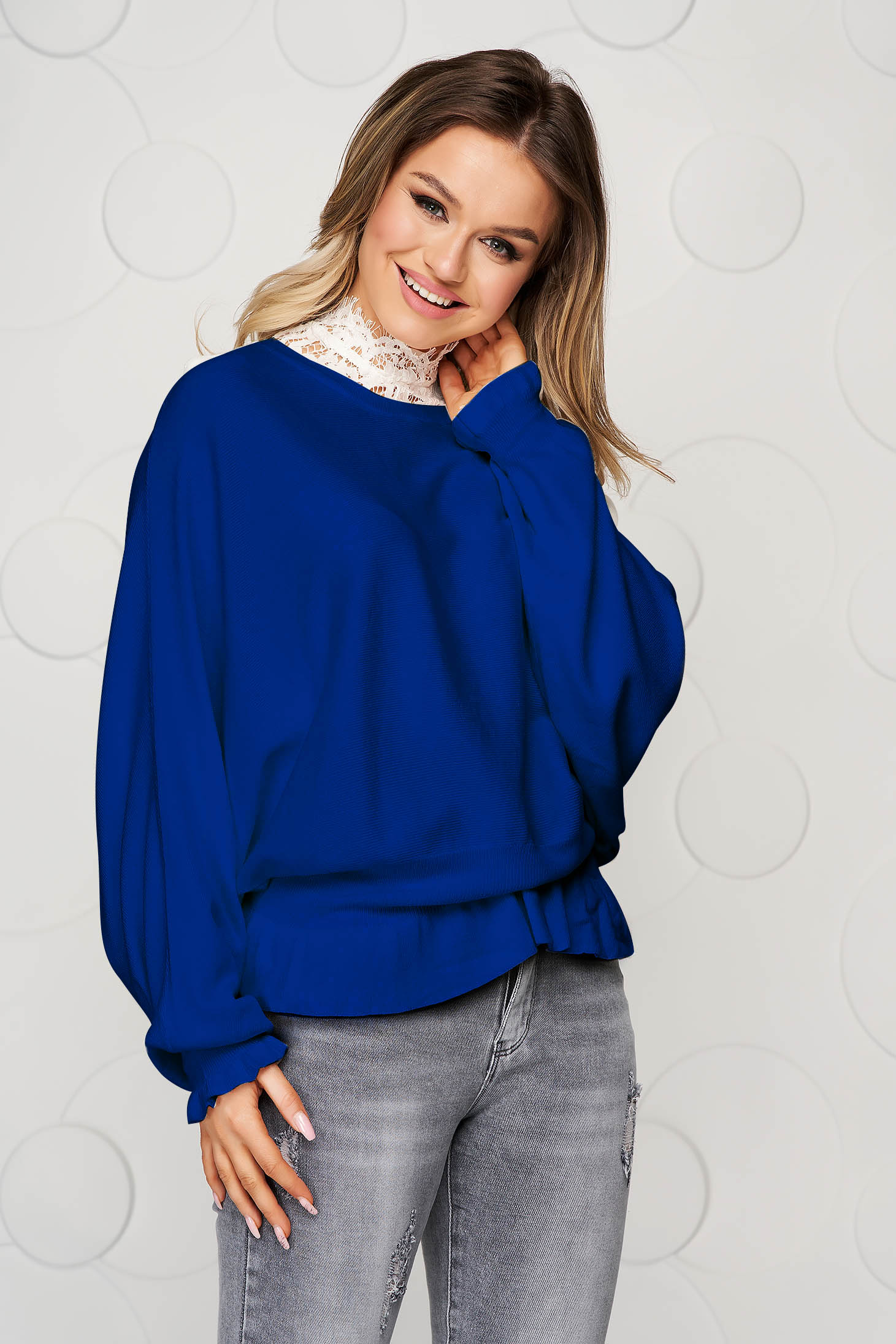 Blue women`s blouse casual knitted from elastic and fine fabric from striped fabric with ruffle details