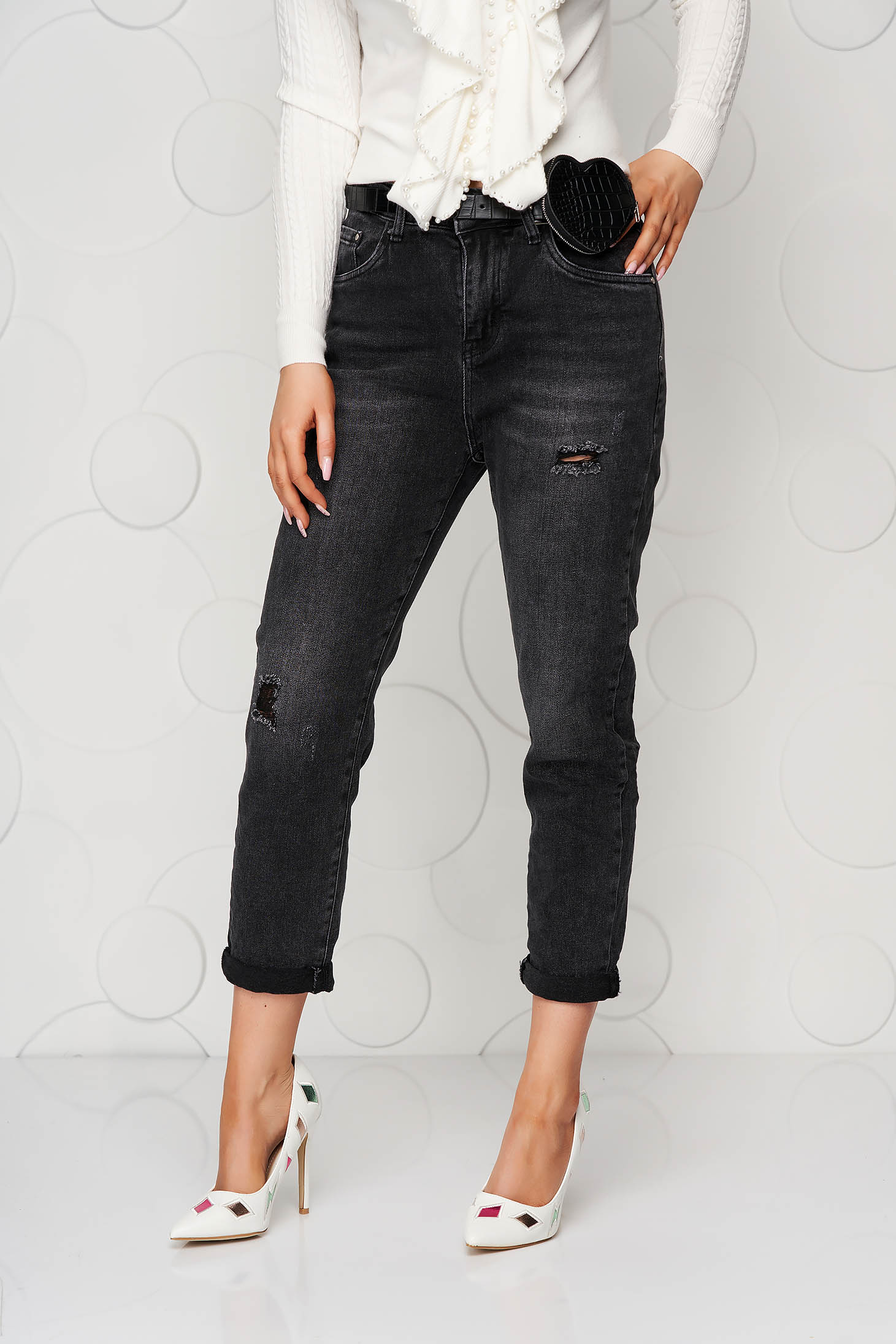 Black jeans accessorized with belt small rupture of material casual