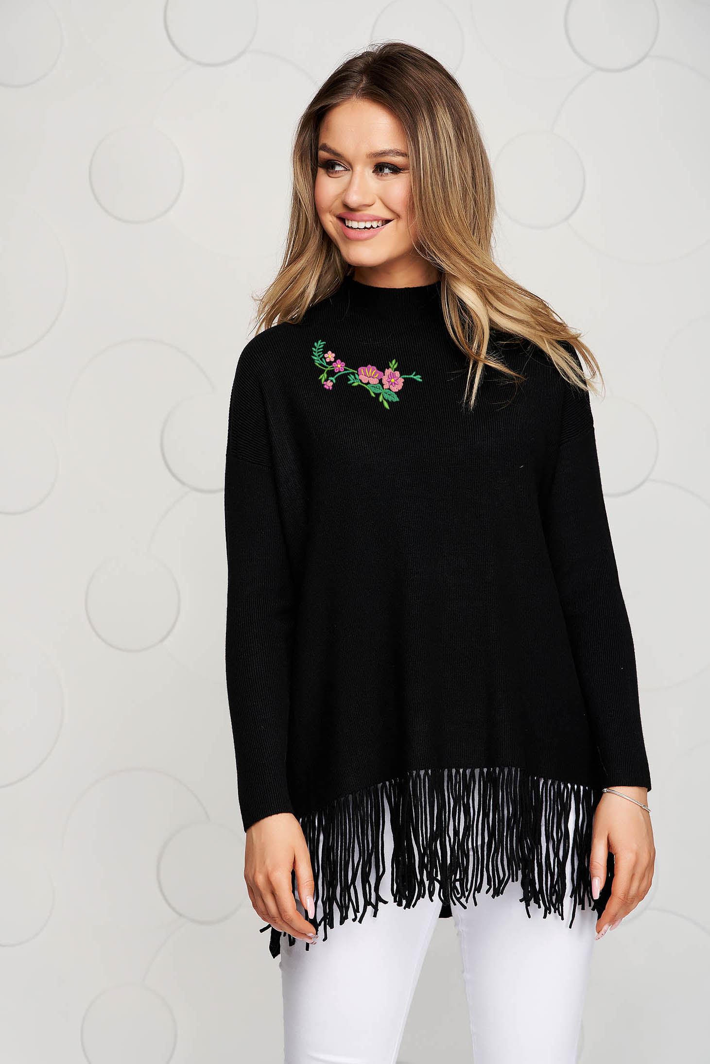 Black women`s blouse knitted from soft fabric from striped fabric casual with fringes at the bottom