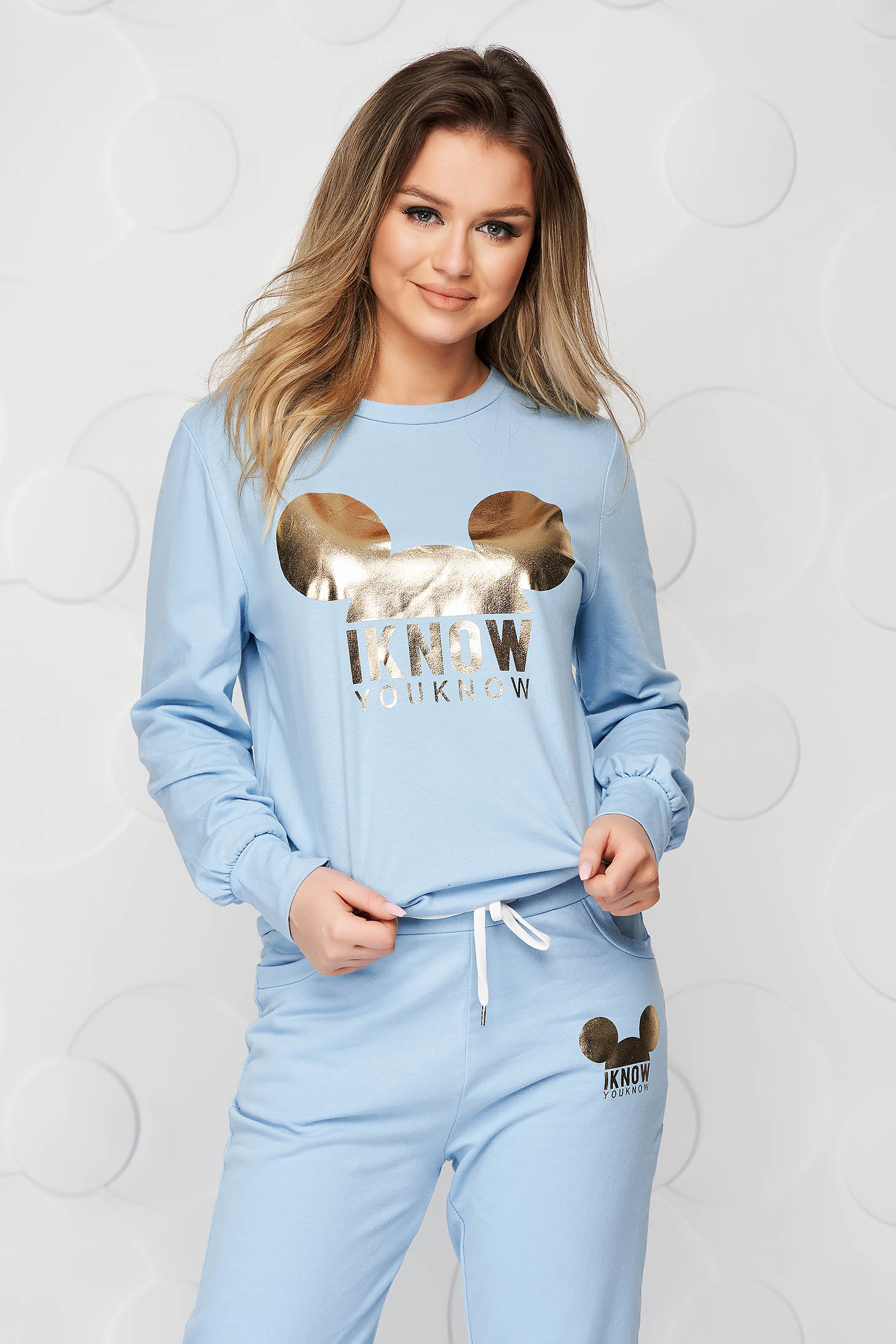 From two pieces lightblue sport 2 pieces loose fit with graphic details