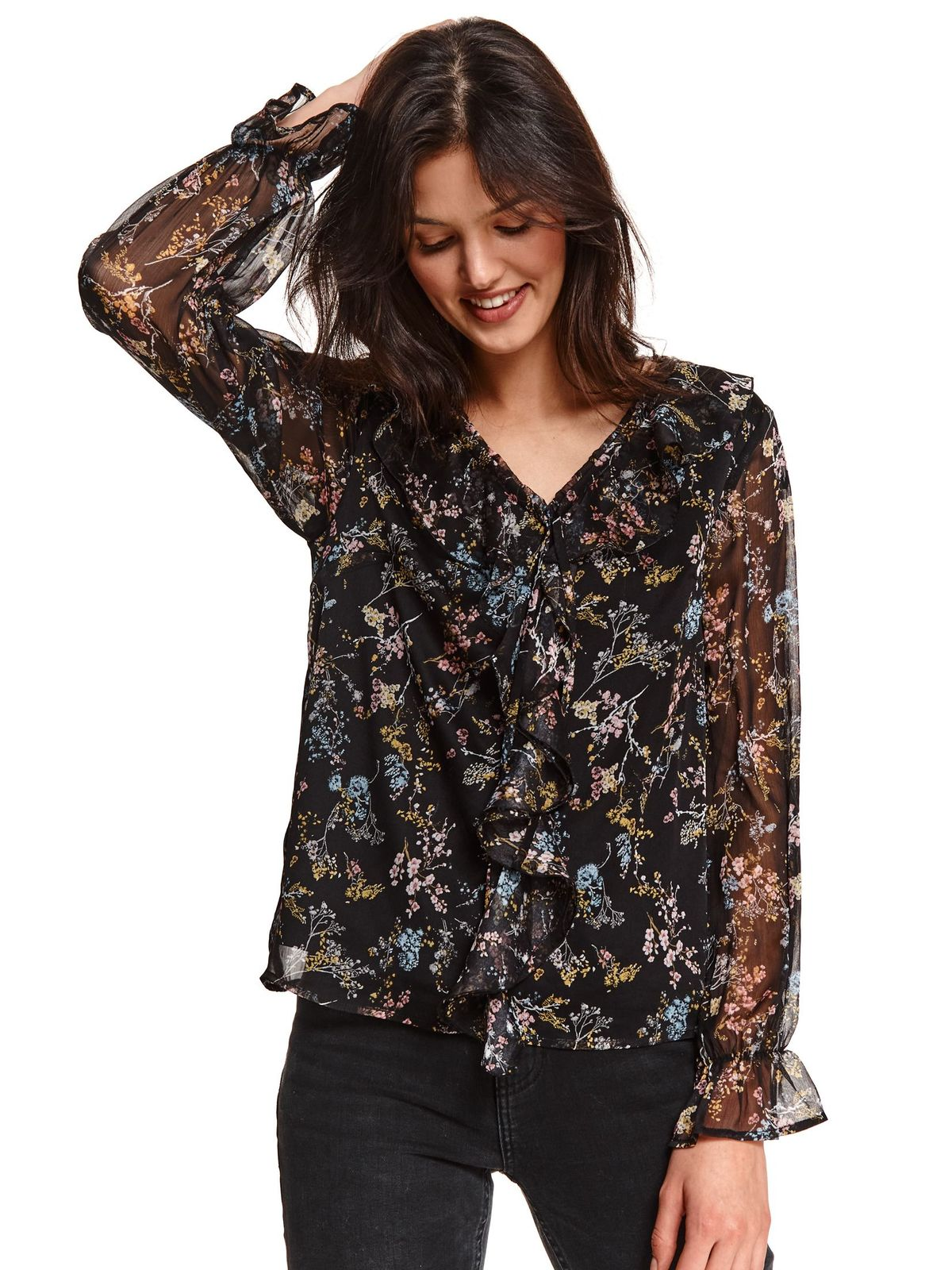 Black women`s blouse from veil fabric with floral print with ruffle details