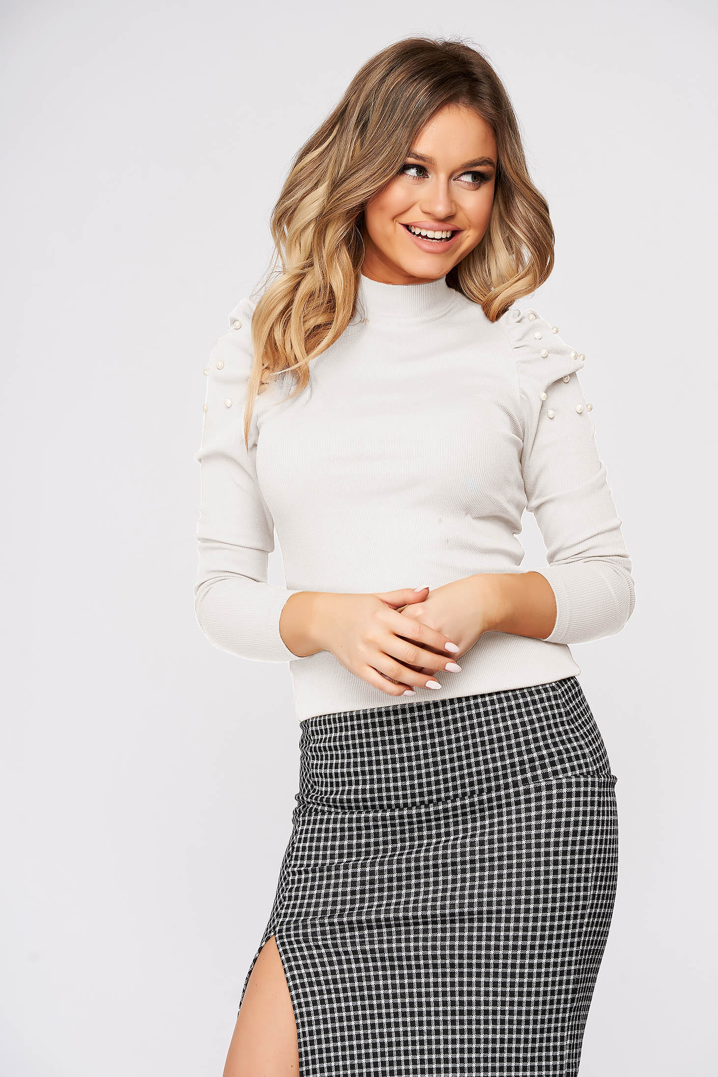 White women`s blouse with turtle neck high shoulders tented from striped fabric