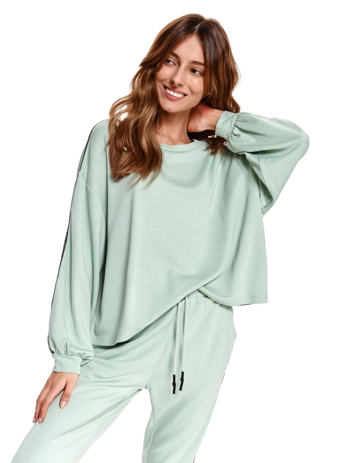 Turquoise women`s blouse with puffed sleeves loose fit from elastic fabric